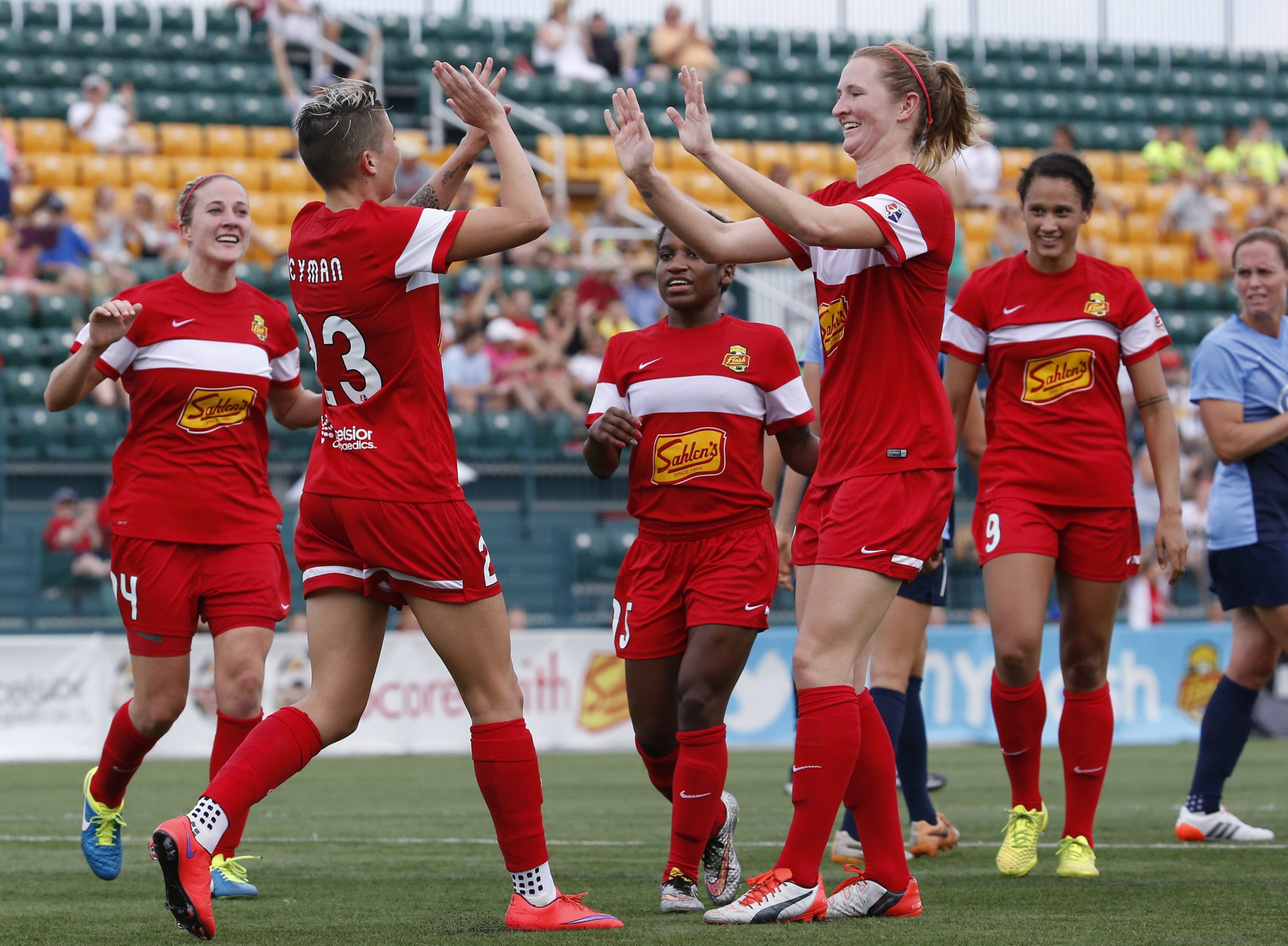 Western New York Flash players celebrate during a game last season at Rhinos Stadium, which was unavailable last week.