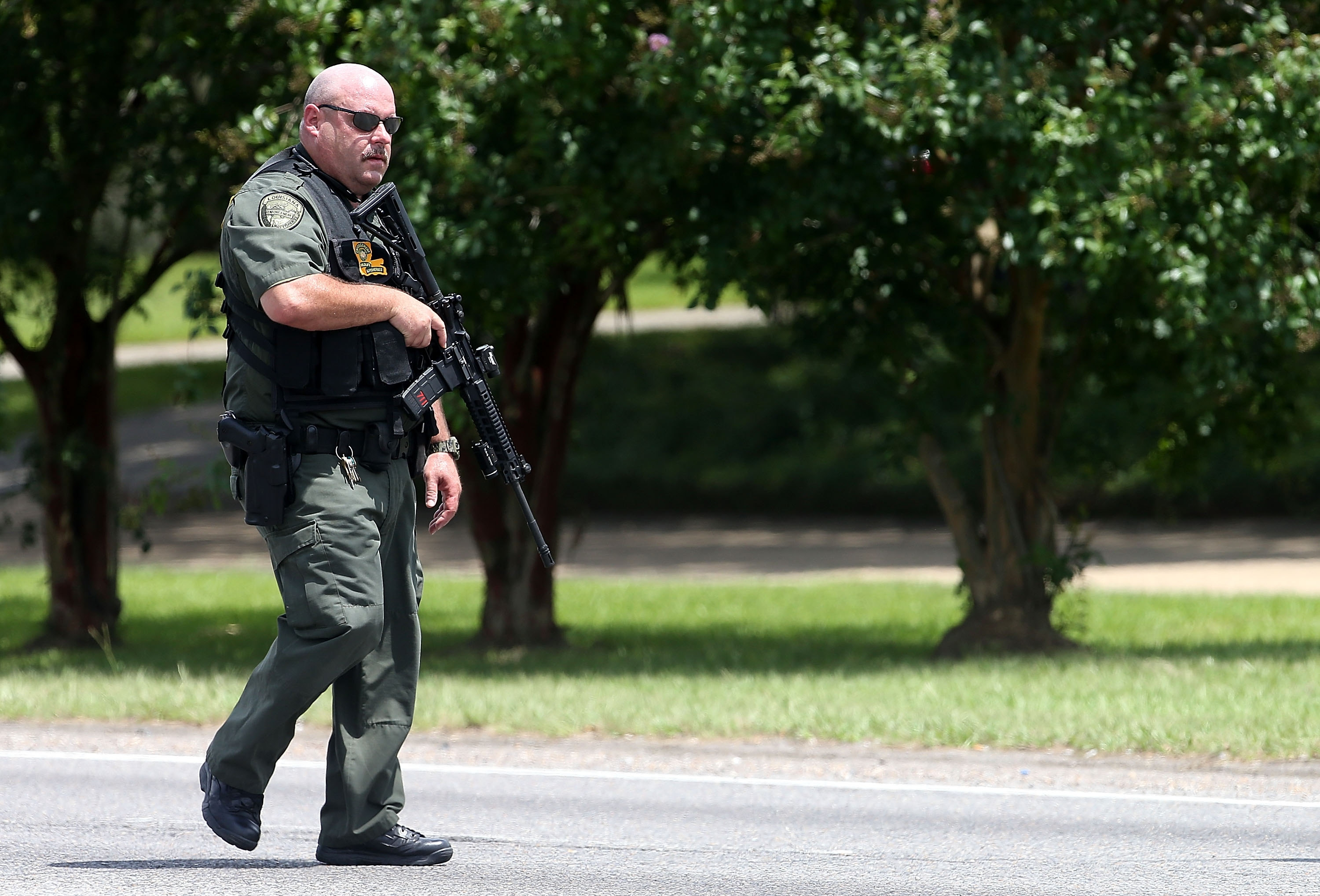 Baton Rouge Police officers patrol Airline Highway after three police officers were killed early the morning of July 17 in Baton Rouge, La. (Sean Gardner/Getty Images)