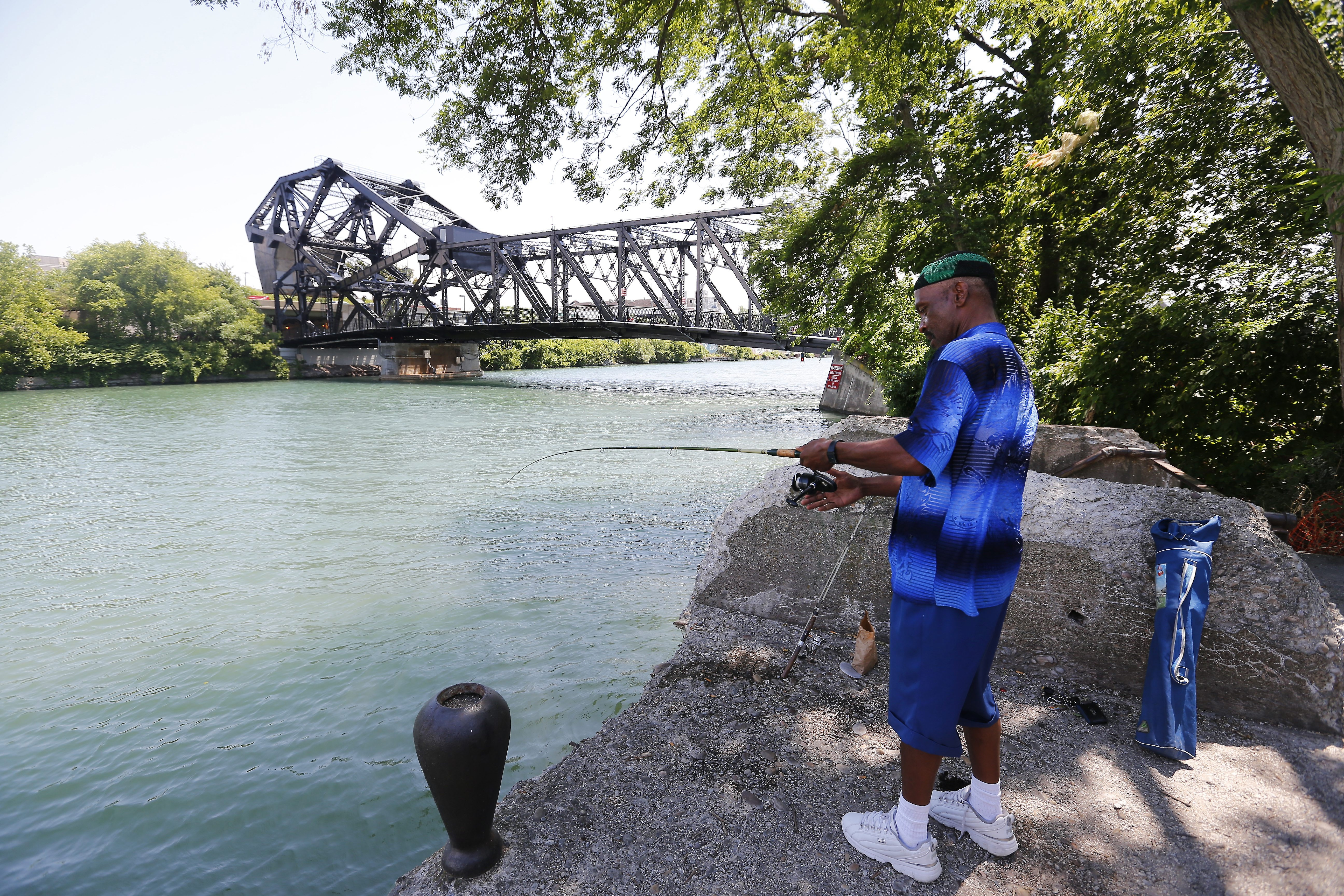 """Walkman"" Walker fishes near 100-year-old Ferry Street lift bridge, which reopened in June after almost $8 million in reconstruction."