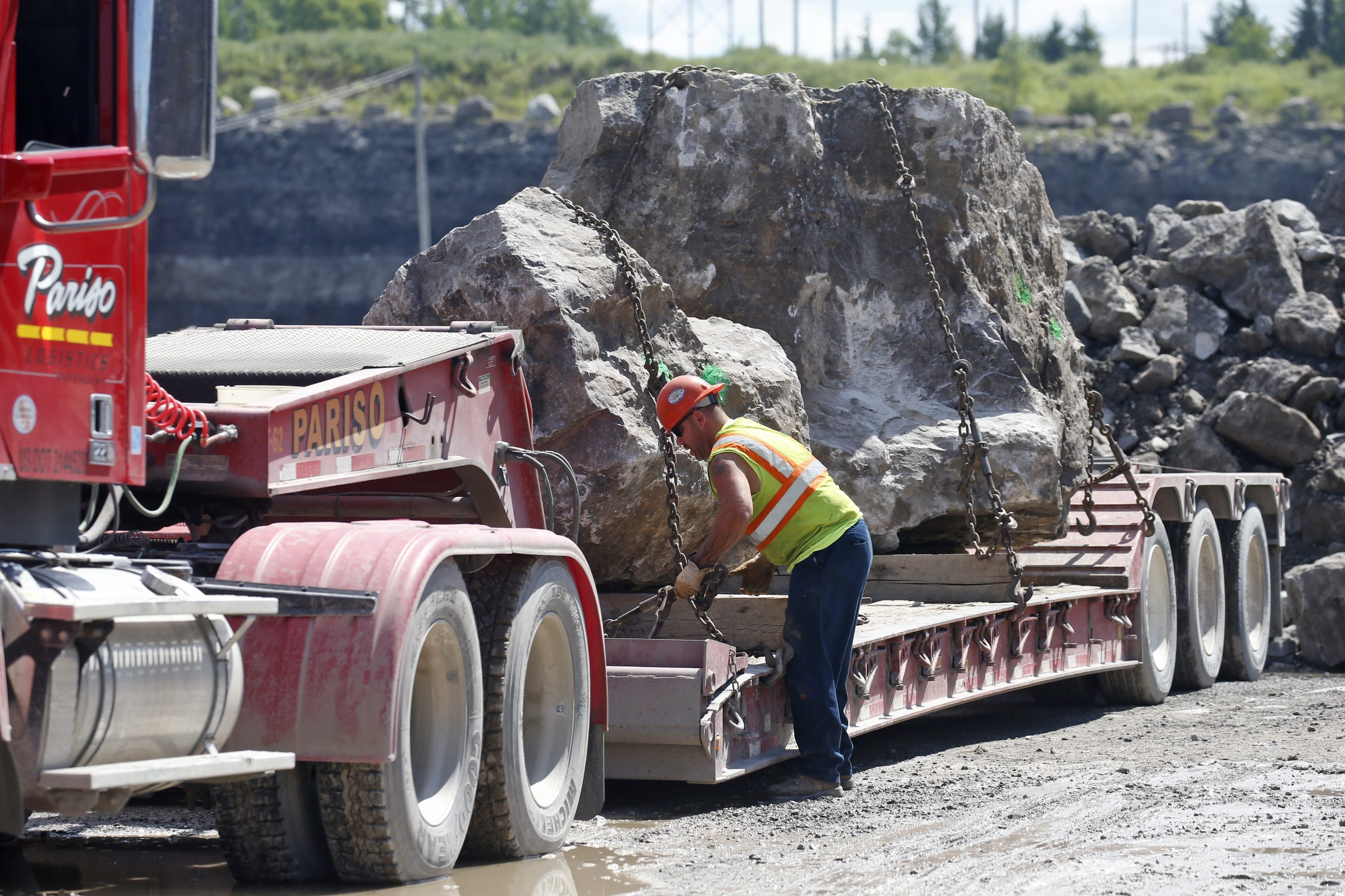 A driver secures some large rocks destined for use in a breakwall project in Buffalo's Outer Harbor.