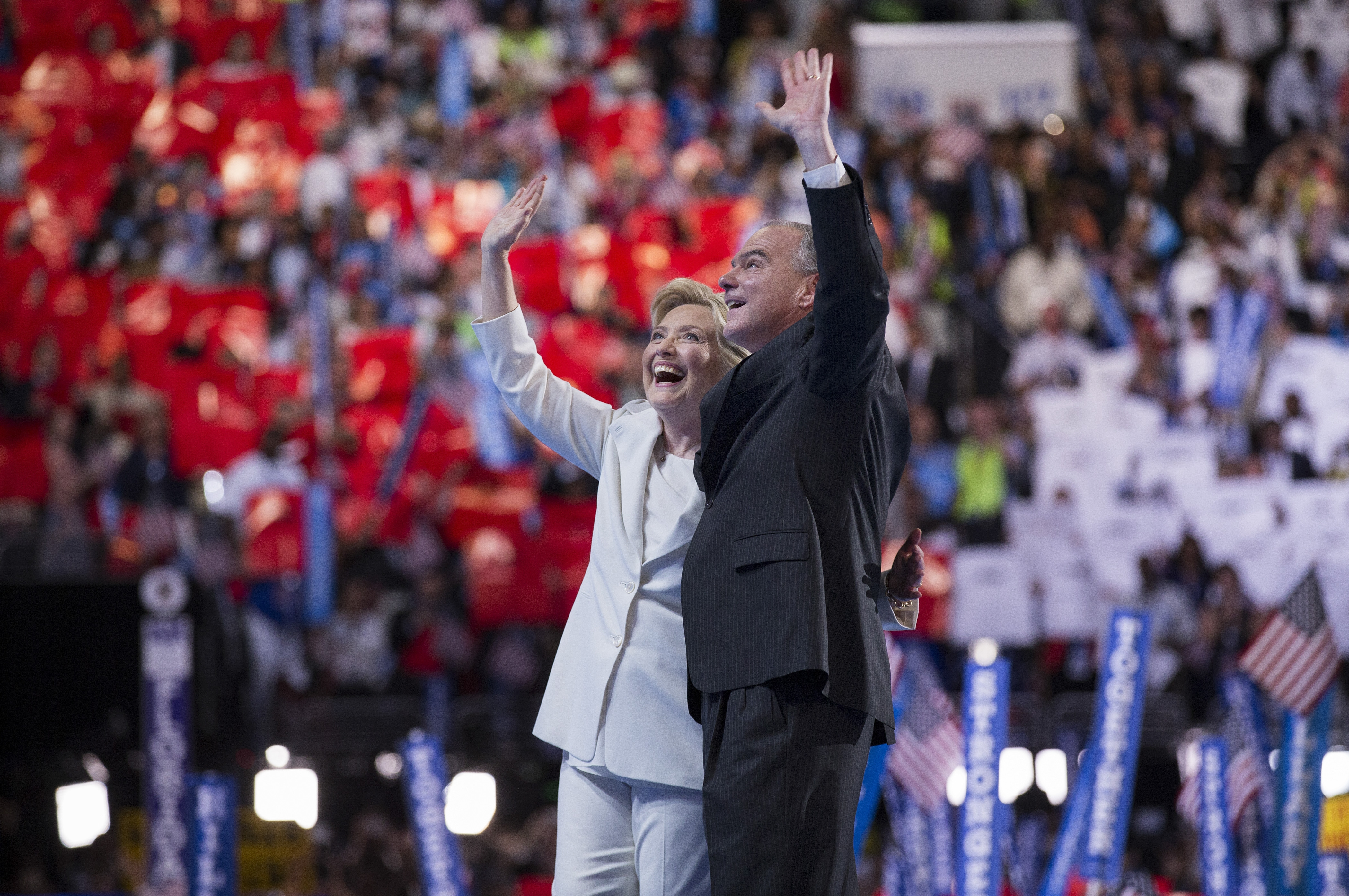 Hillary Clinton is joined on stage by Sen. Tim Kaine, her running mate, after accepting the party's presidential nomination. (New York Times)