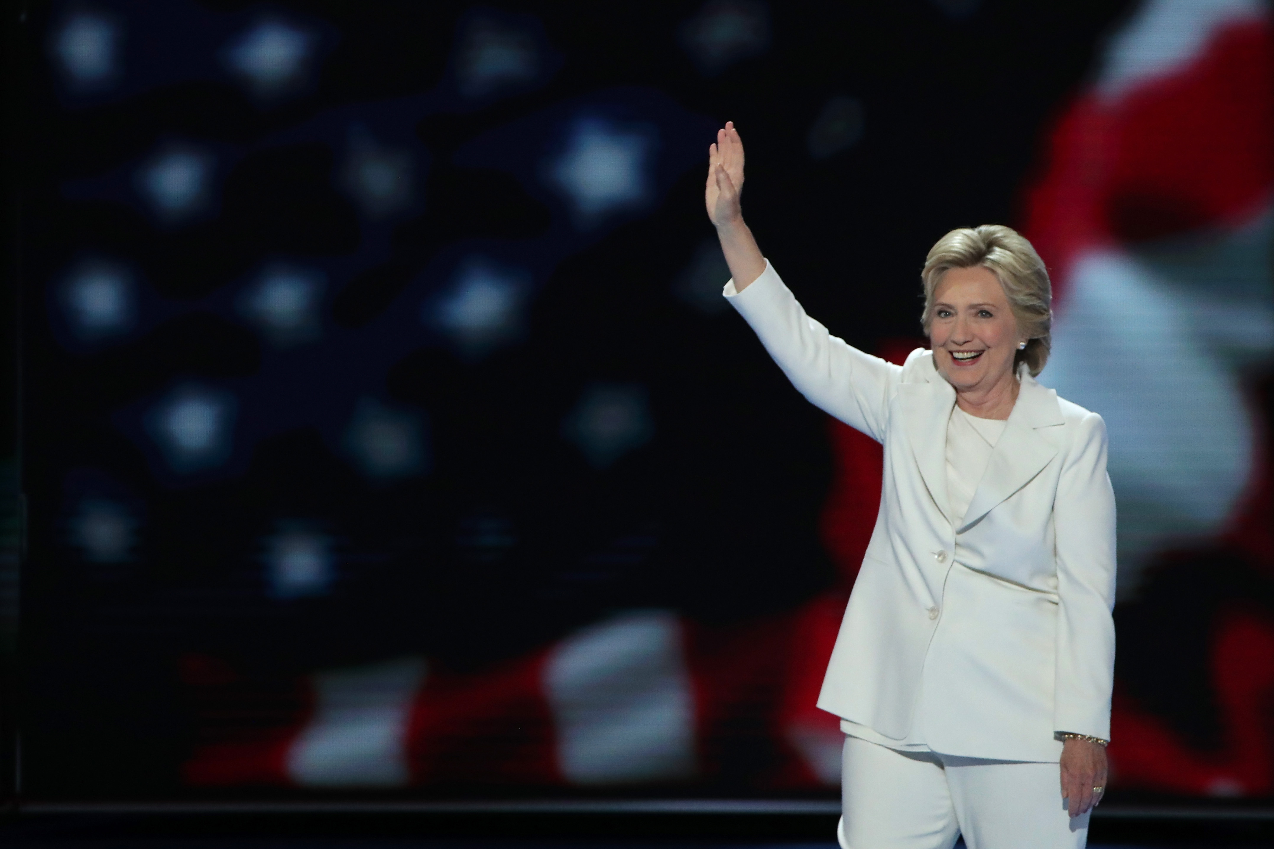 Democratic presidential nominee Hillary Clinton waves to the crowd as she arrives on stage during the fourth day of the Democratic National Convention. (Getty Images)