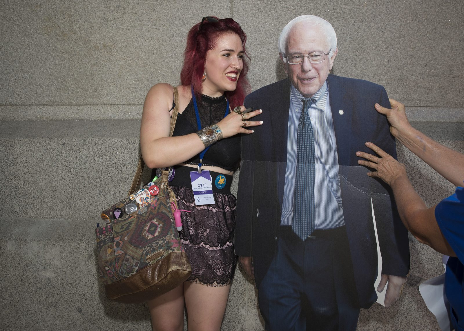 Olivia Love-Hattestad, a supporter of Bernie Sanders and an Illinois delegate, with a cutout of Sanders during a rally the day before the Democratic National Convention in downtown Philadelphia. (Stephen Crowley/The New York Times)