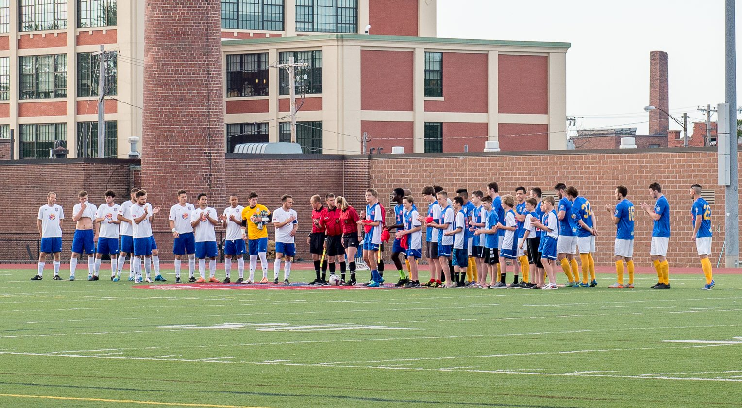 FC Buffalo and Erie line up at midfield before their first meeting, on May 27 at Robert E. Rich All High Stadium. (Matt Weinberg/Special to The News)