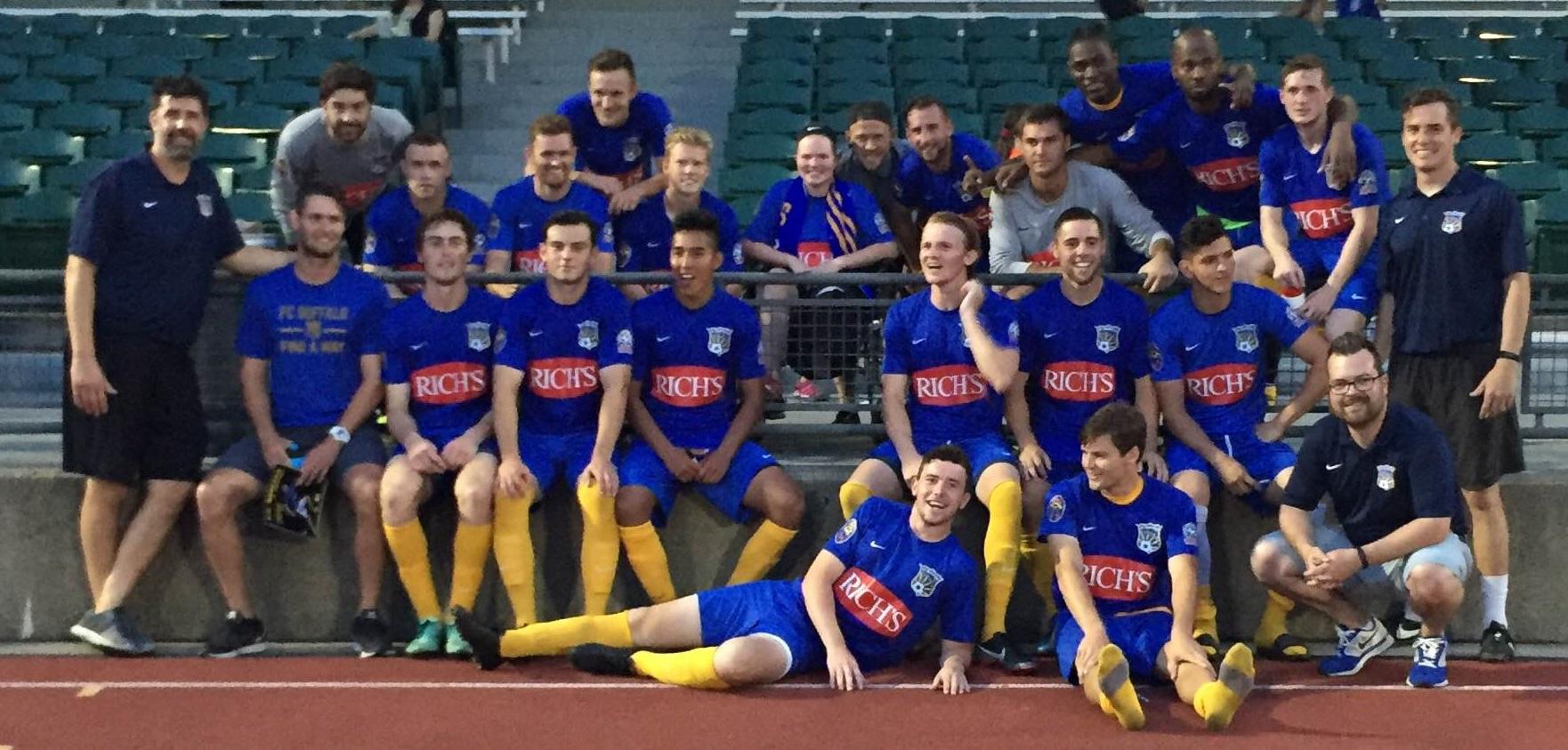 FC Buffalo's players pose with a fan following their season-ending 2-0 win. (Ben Tsujimoto/Buffalo News)