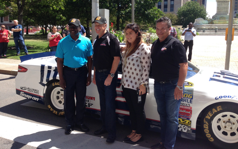 Rusty Wallace stands in front of his No. 2 car with Buffalo mayor Byron Brown, Watkins Glen CEO Michael Printup and a representative from New Era (Jack Goods/Buffalo News)