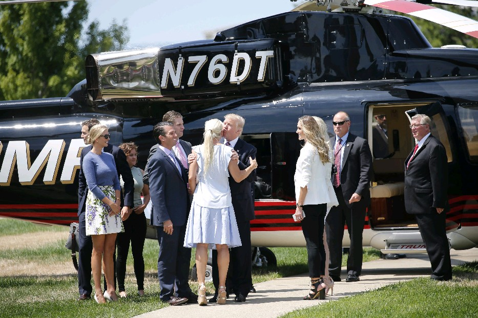 Presidential candidate Donald Trump kisses his daughter Ivanka after landing in his helicopter outside the Great Lakes Science Center as he arrives in Cleveland for the Republican National Convention on Wednesday. Ivanka is scheduled to speak at tonight's events just before her father is expected to accept the nomination for president. (Derek Gee/Buffalo News)