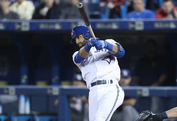 Jose Bautista hits town Friday night (Getty Images).