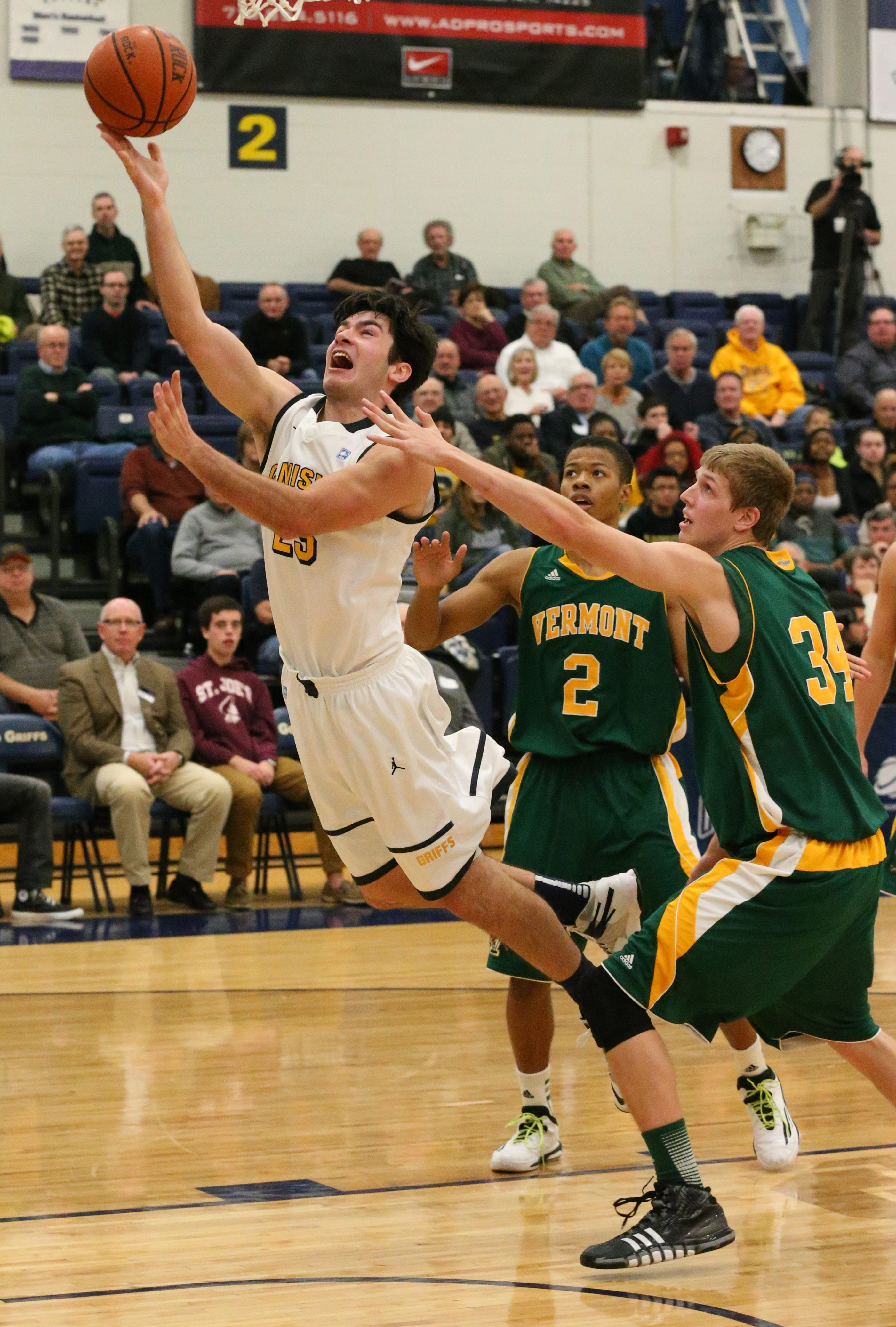 Canisius College guard Adam Weir (25) drives to the basket on Vermont on Nov. 15, 2014. (James P. McCoy/ Buffalo News)