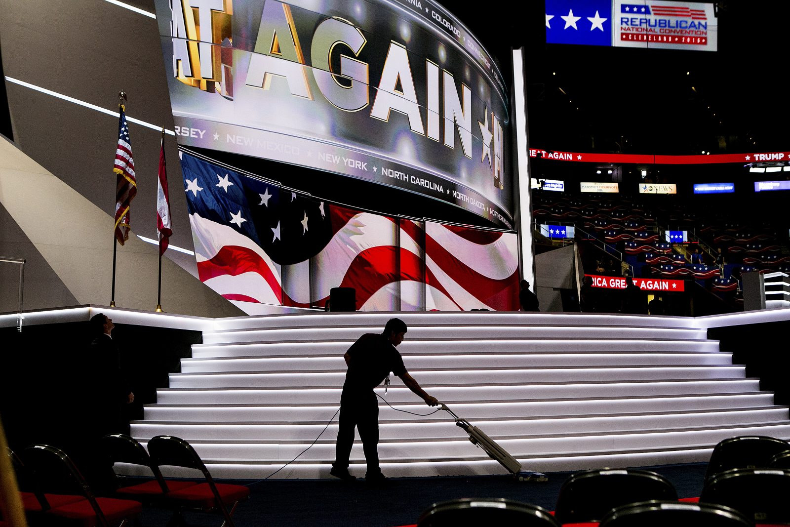 A worker vacuums the floor in the Quicken Loans Arena on Day Two of the Republican National Convention. (Sam Hodgson/New York Times)