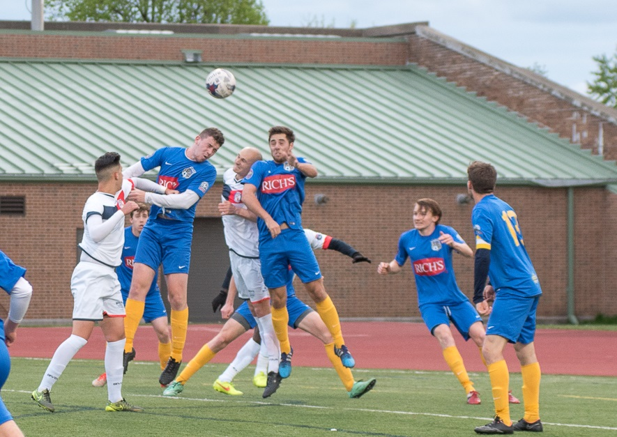 Toland, left in the air, Donaldson, middle in the air, rise for a header, while McBeth, second from right, provides cover. (Matt Weinberg/Special to The News)