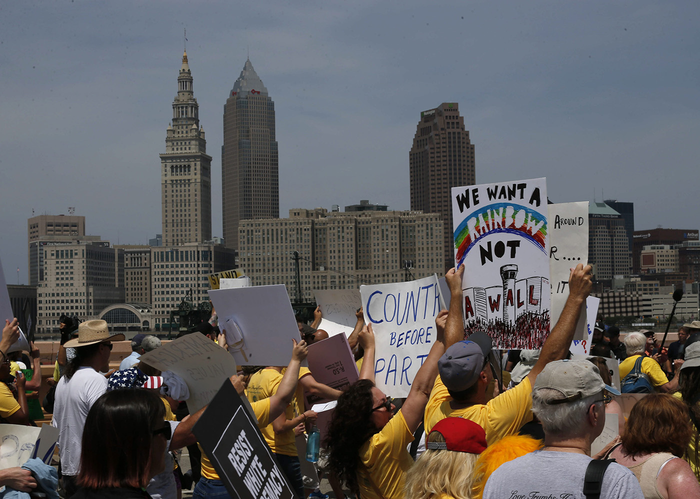 """Protesters march in the """"Stand Together Against Trump"""" parade across the Hope Memorial Bridge in Cleveland, Thursday, July 21, 2016. (Photo by Derek Gee)"""