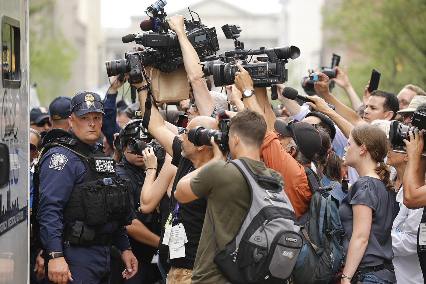 A South Carolina State Trooper is surrounded by news cameras as a protestor is detained in Cleveland, Ohio, Monday, July 18, 2016.  (Photo by Derek Gee)
