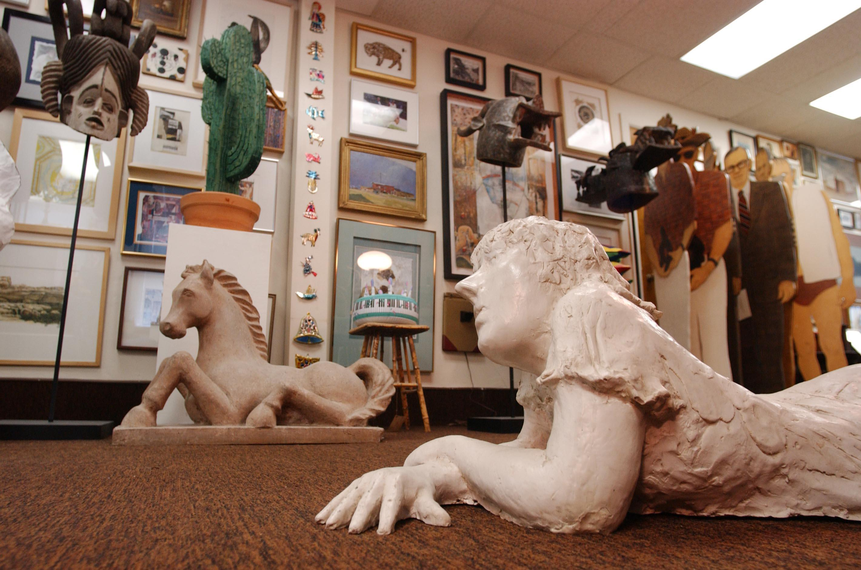 "Kathy Leacock help organize Charles Rand Penney's collection, which included these pieces. ""Gertrude"" is the sculpture keeping watch. (Bill Wippert/Buffalo News file photo)"
