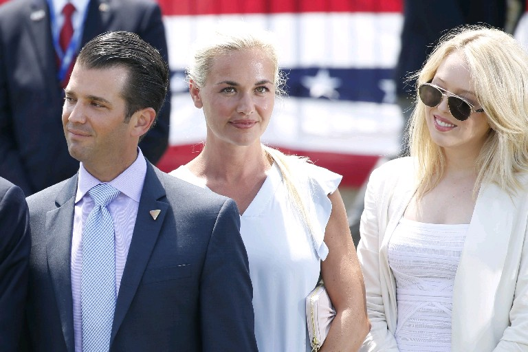 Children of presidential candidate Donald Trump, from left, Donald Trump Jr., Ivanka Trump and Tiffany Trump look on as their father speaks after his arrival outside the Great Lakes Science Center as he arrives in Cleveland for the Republican National Convention on Wednesday. Ivanka is scheduled to speak at tonight's events just before her father is expected to accept the nomination for president. (Derek Gee/Buffalo News)