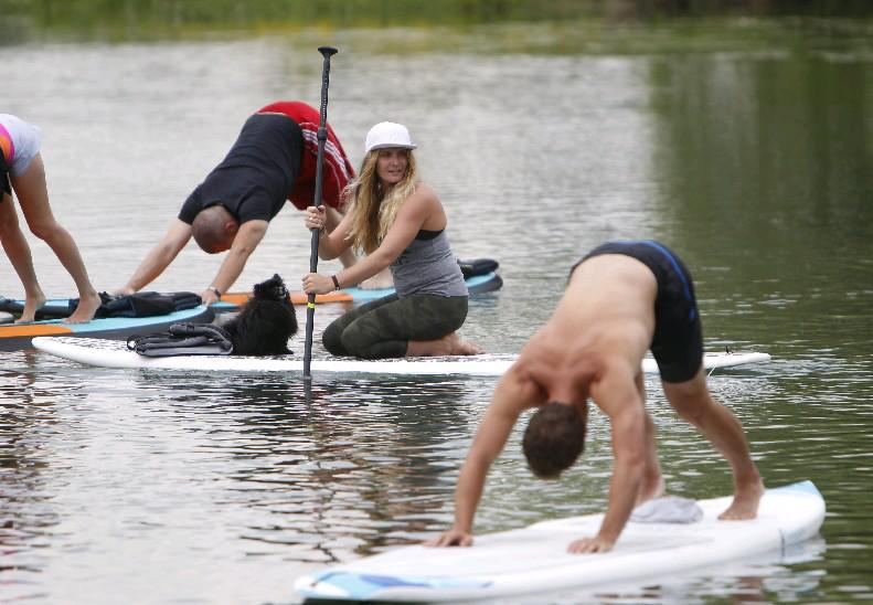 Marie Phillips will lead a Stand-Up Paddleboard yoga class on Sunday as part of the Budding Tree Yoga Festival at Wilkeson Pointe on the Outer Harbor. See the complete schedule for the free festival below. (Sharon Cantillon/Buffalo News file photo)