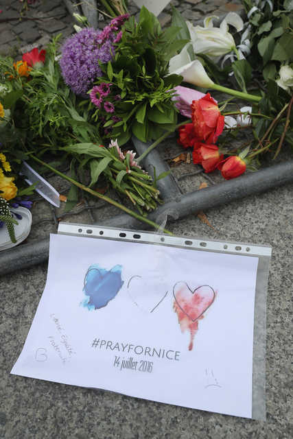 BERLIN, GERMANY - A piece of paper reading 'Pray for Nice' lies among flowers left by mourners outside the French Embassy the day after the terror attack in Nice that has left at least 84 people dead on July 15. (Getty Images)