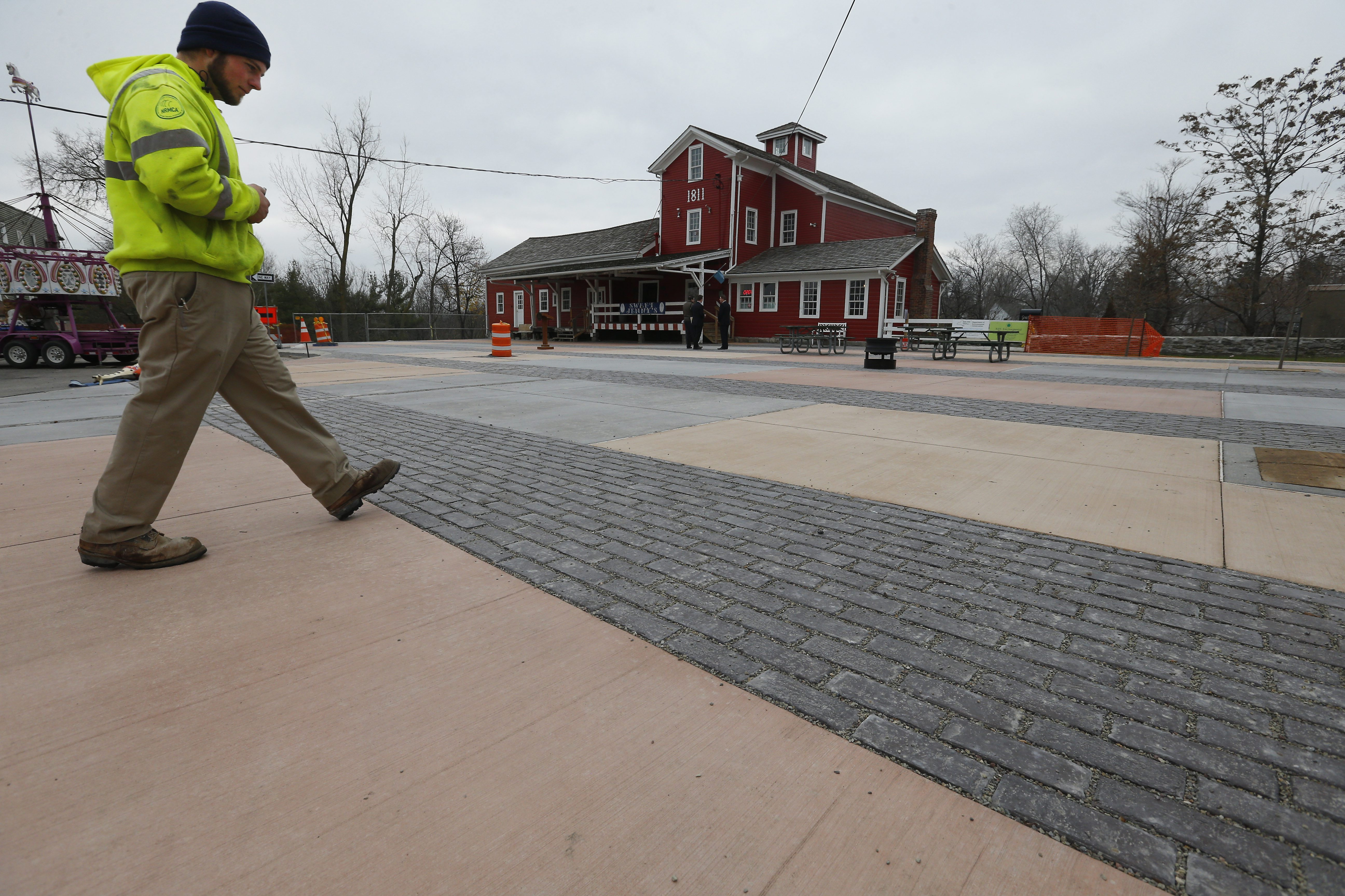 John Long of United Materials walks in front of the historic water mill in Williamsville on Friday, December 4, 2015.  (Mark Mulville/Buffalo News)
