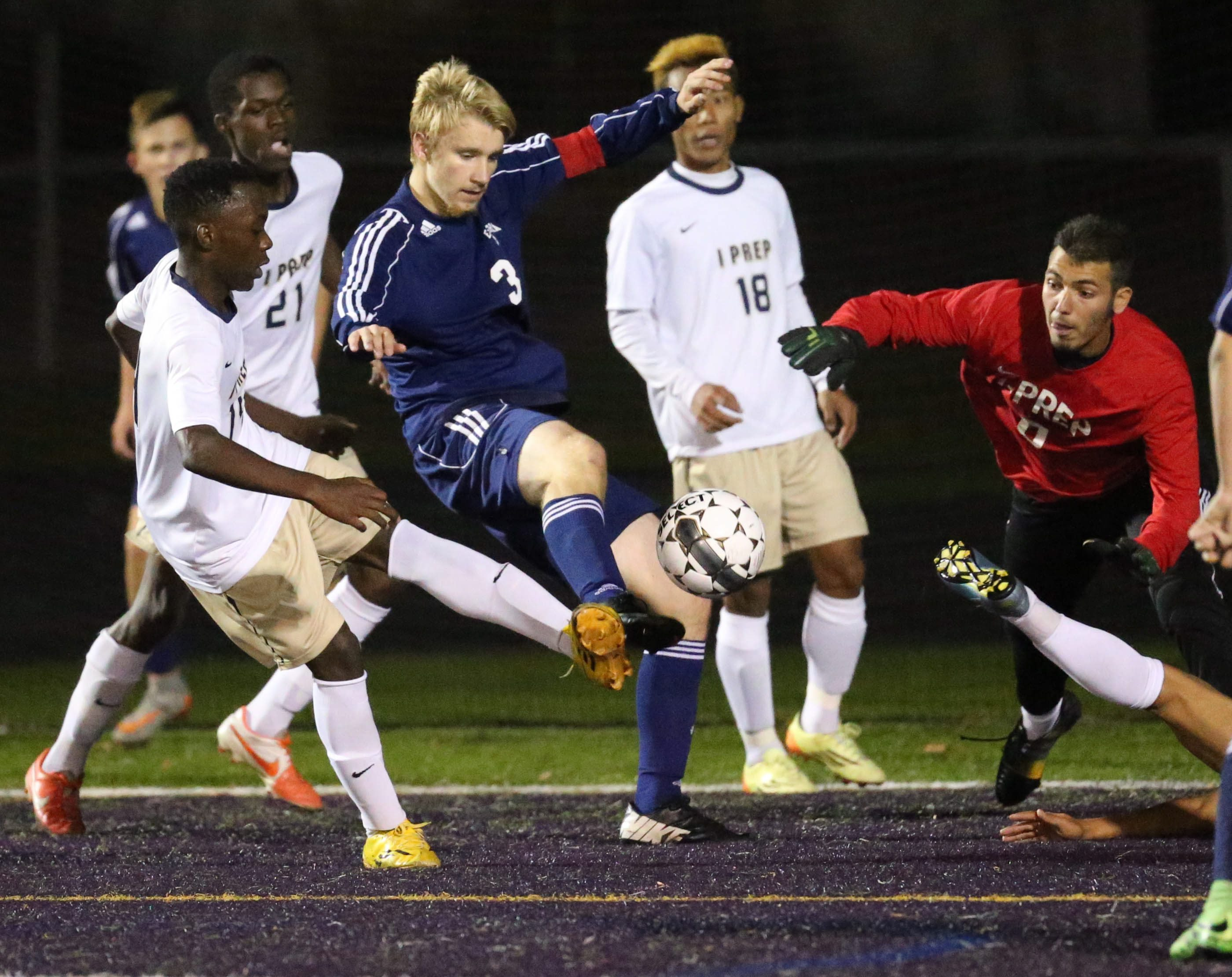East Aurora's Noah Thompson battles I-Prep's Mugisho Bagalwa for the ball in the first half during the 2015 Section VI Class B overall final. (James P. McCoy/ Buffalo News)