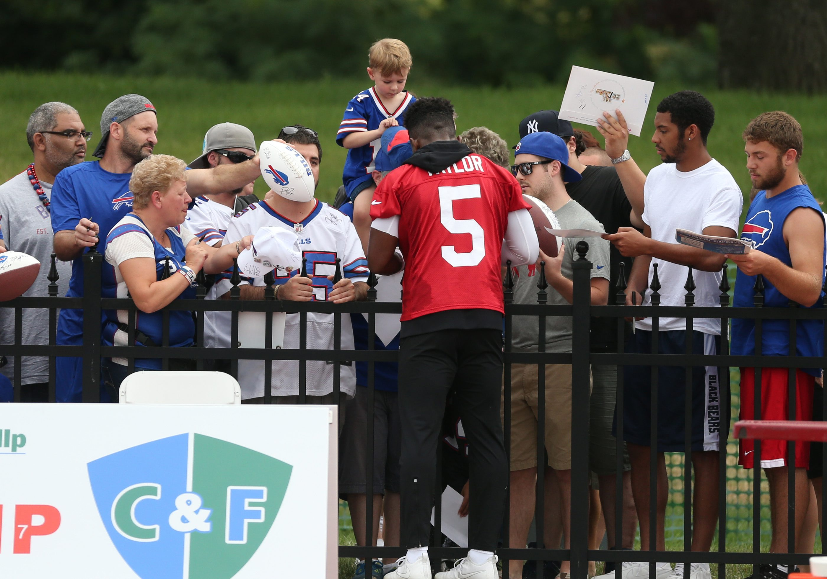 Buffalo Bills quarterback Tyrod Taylor (5) signs autographs after Saturday's first day of the 2016 training camp at St. John Fisher College in Pittsford. (James P. McCoy/ Buffalo News)