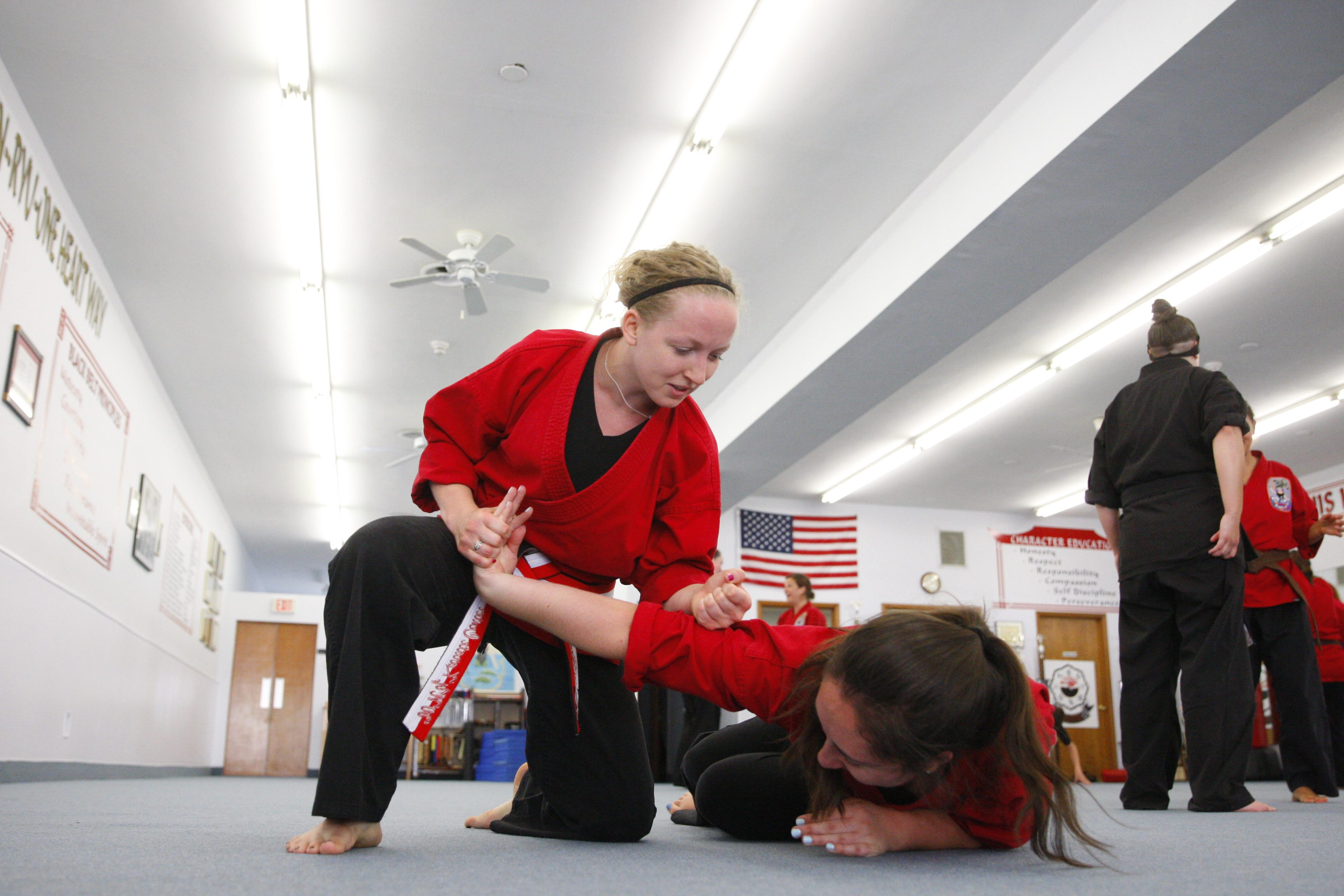 Alicia Hargadon(blonde hair) trains with Kayla Simpson a nurse at Roswell Park, earned a fifth-degree black belt trines at the New York Karate Center on Tuesday, Aug. 2, 2016. (Harry Scull Jr./Buffalo News)