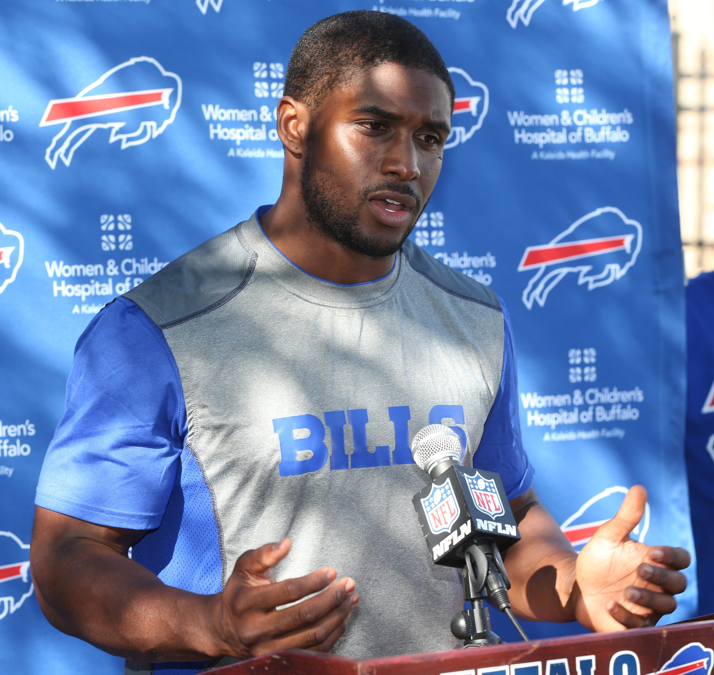 Reggie Bush talks to the press after signing a contract with the Buffalo Bills.  (James P. McCoy/Buffalo News)