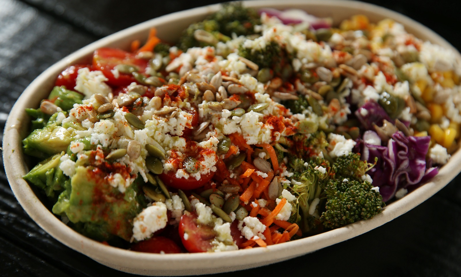 Newbury Salad's spicy quinoa crunch bowl is made with spicy quinoa, raw organic corn, red cabbage, spicy broccoli, carrots, grape tomatoes, avocado, spicy sunflower seeds, toasted pumpkin seeds, feta and a jalapeño lime cilantro dressing.  (Sharon Cantillon/Buffalo News)