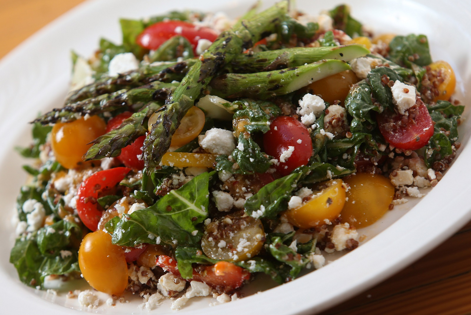 Osteria 166 offers the insalada potenza, which is made with Swiss chard tossed with red quinoa, cucumber, child roasted peppers, roasted cauliflower, asparagus and feta cheese and blood orange vinaigrette.  (Sharon Cantillon/Buffalo News)
