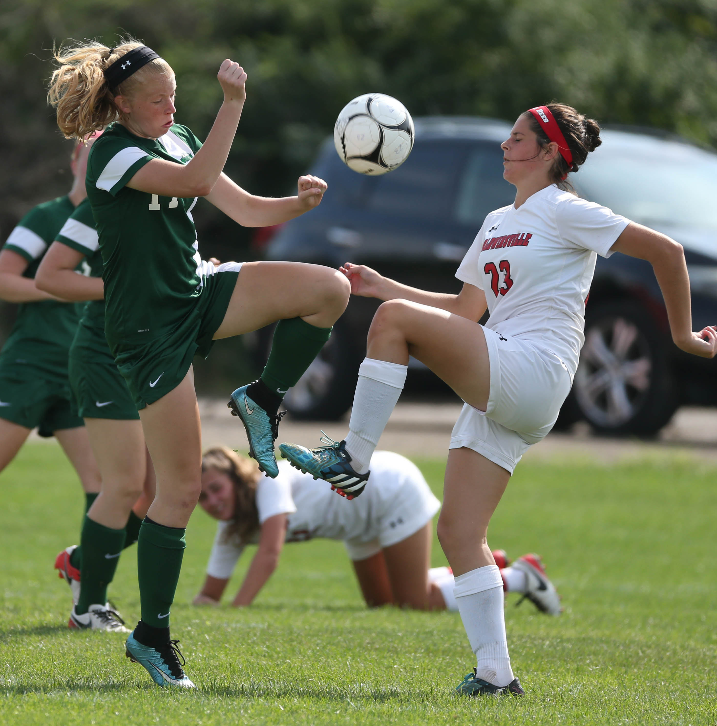 Nardin's Allison Busha battles Baldwinsville's Simone Neivel for the ball in the second half of a game at the  Clarence Tournament.  (James P. McCoy/ Buffalo News)