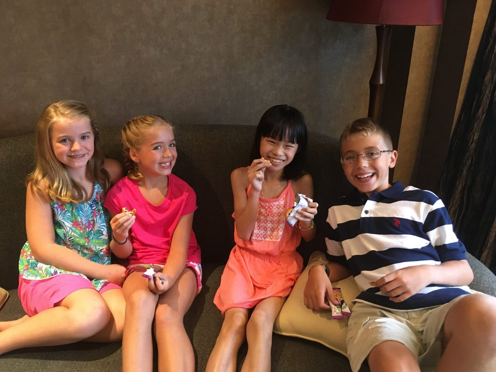 Fen, center, with her new siblings after they met in China. Two more siblings are waiting at home in Lockport to meet her. (Photo courtesy of the Foster family)