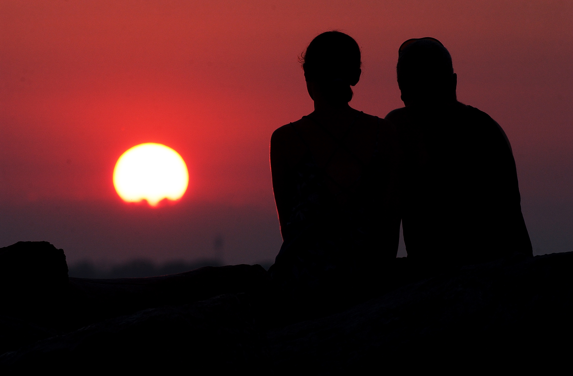 A couple enjoys the sunset at Erie Basin Marina in Buffalo, which ranked 116 out of 150 U.S. cities as a place to retire. (Buffalo News file photo)
