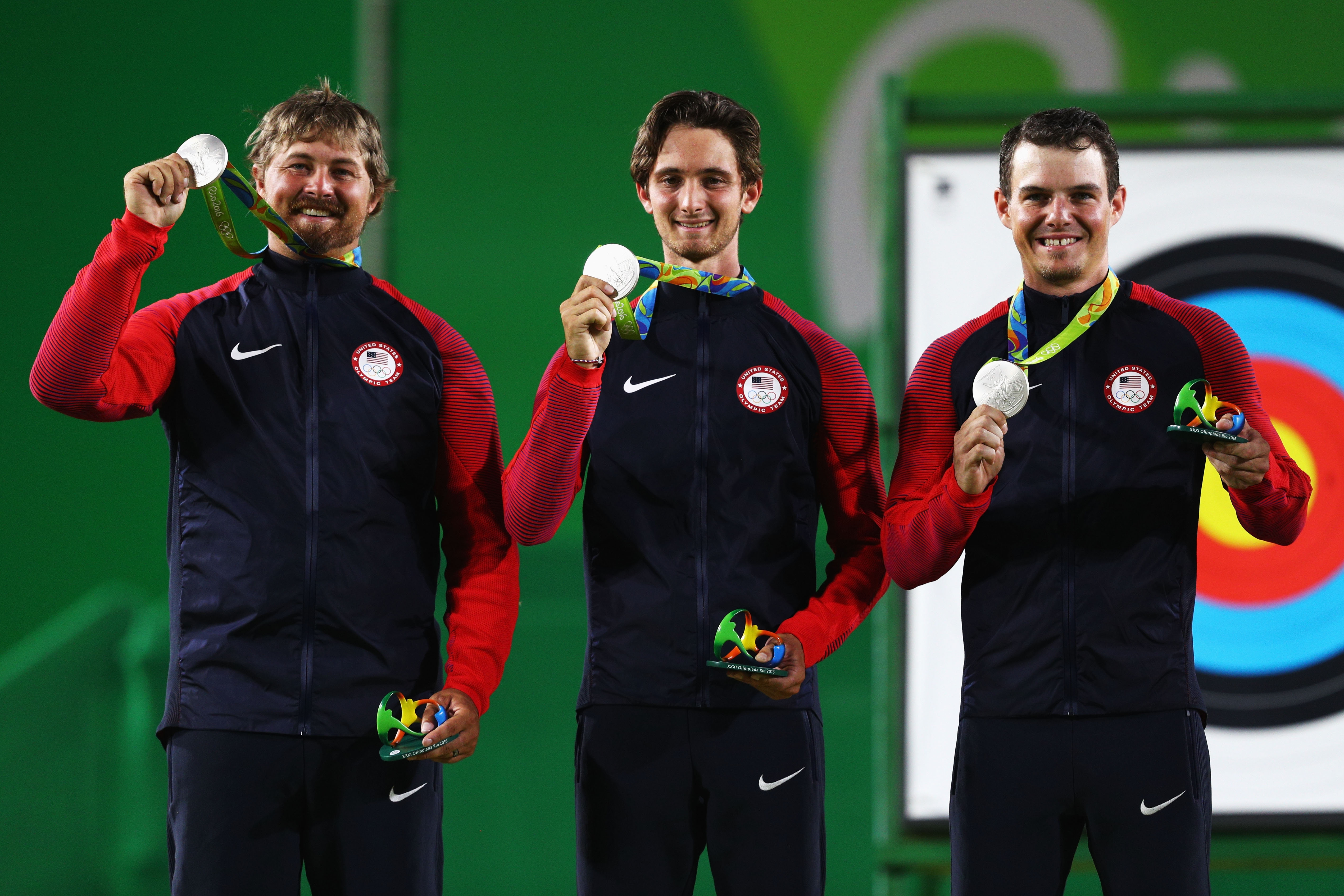 From left, Brady Ellison, Zach Garrett and Jake Kaminski of the United States celebrate with their silver medals for men's archery. Kaminski, an Elma native, was also on a silver-winning team in 2012.