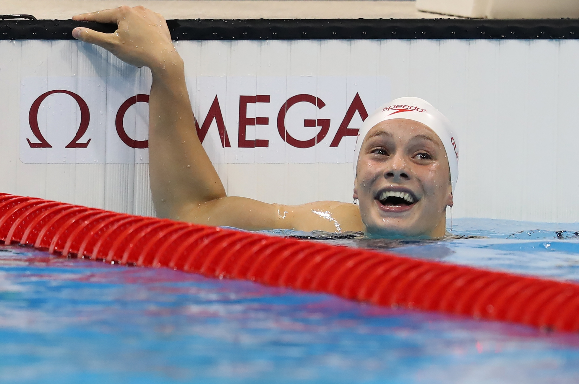 Penny Oleksiak, 16, of Canada, wins the silver medal in the women's 100-meter butterfly Sunday in Rio de Janeiro. Penny's dad, Richard, is a Buffalo native who was a Hall of Fame athlete at Nichols School.