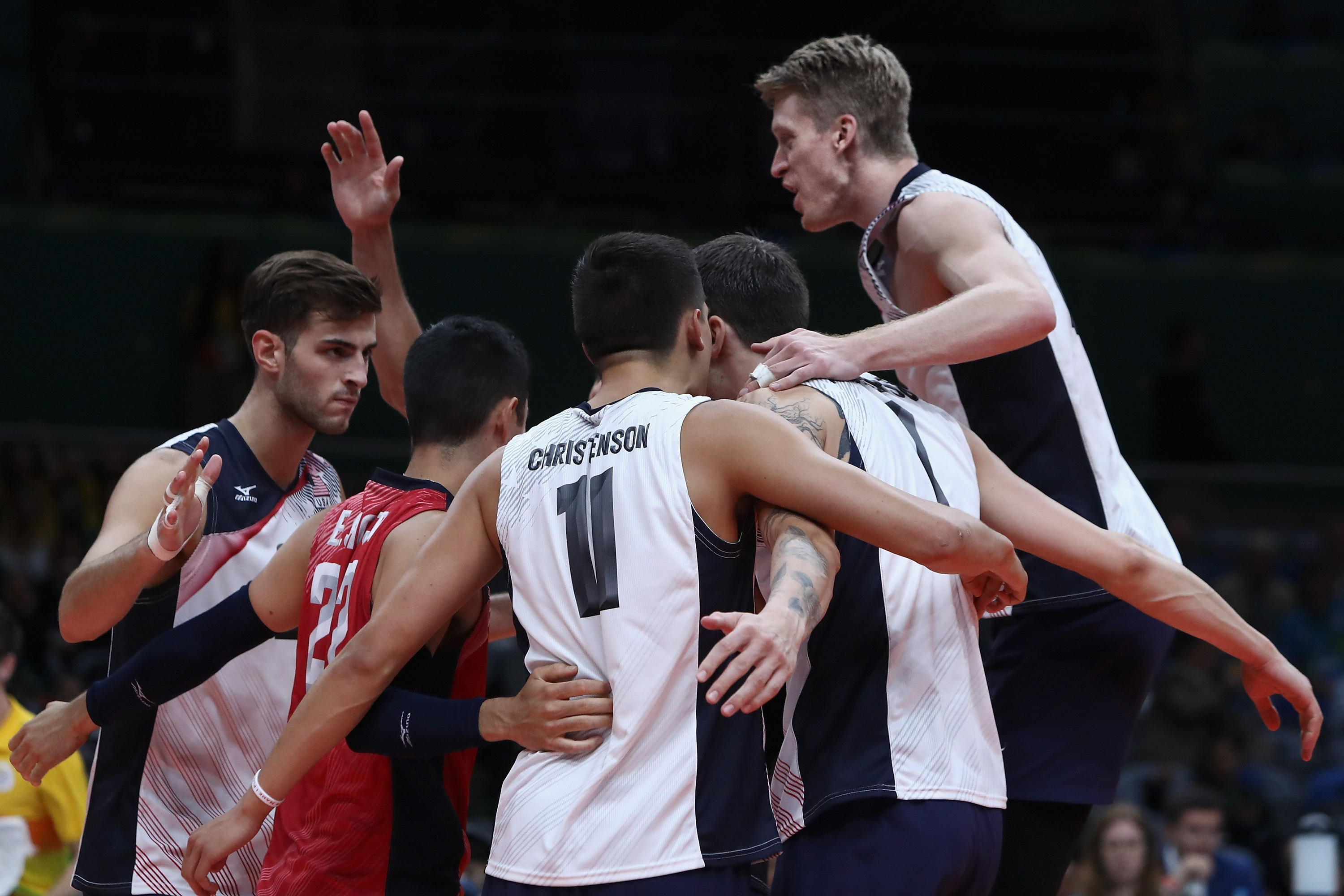 Matt Anderson (No. 1) and his United States teammates celebrate a point during Thursday night's upset of Brazil on its home turf.
