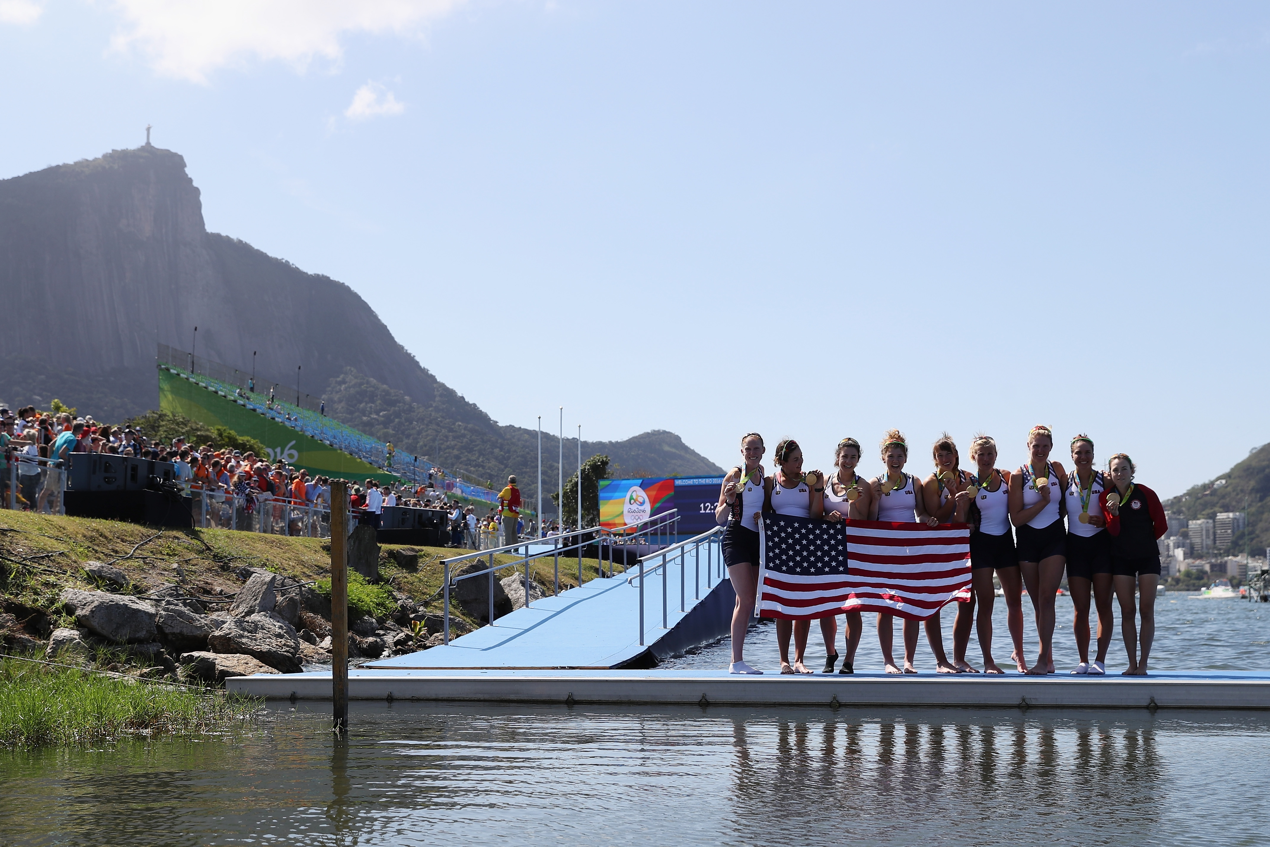 With Christ the Redeemer high above, Buffalo's Emily Regan (far left) and her U.S. women's eight rowing teammates posed with their gold medals at the Rio Olympics. (Getty Images)