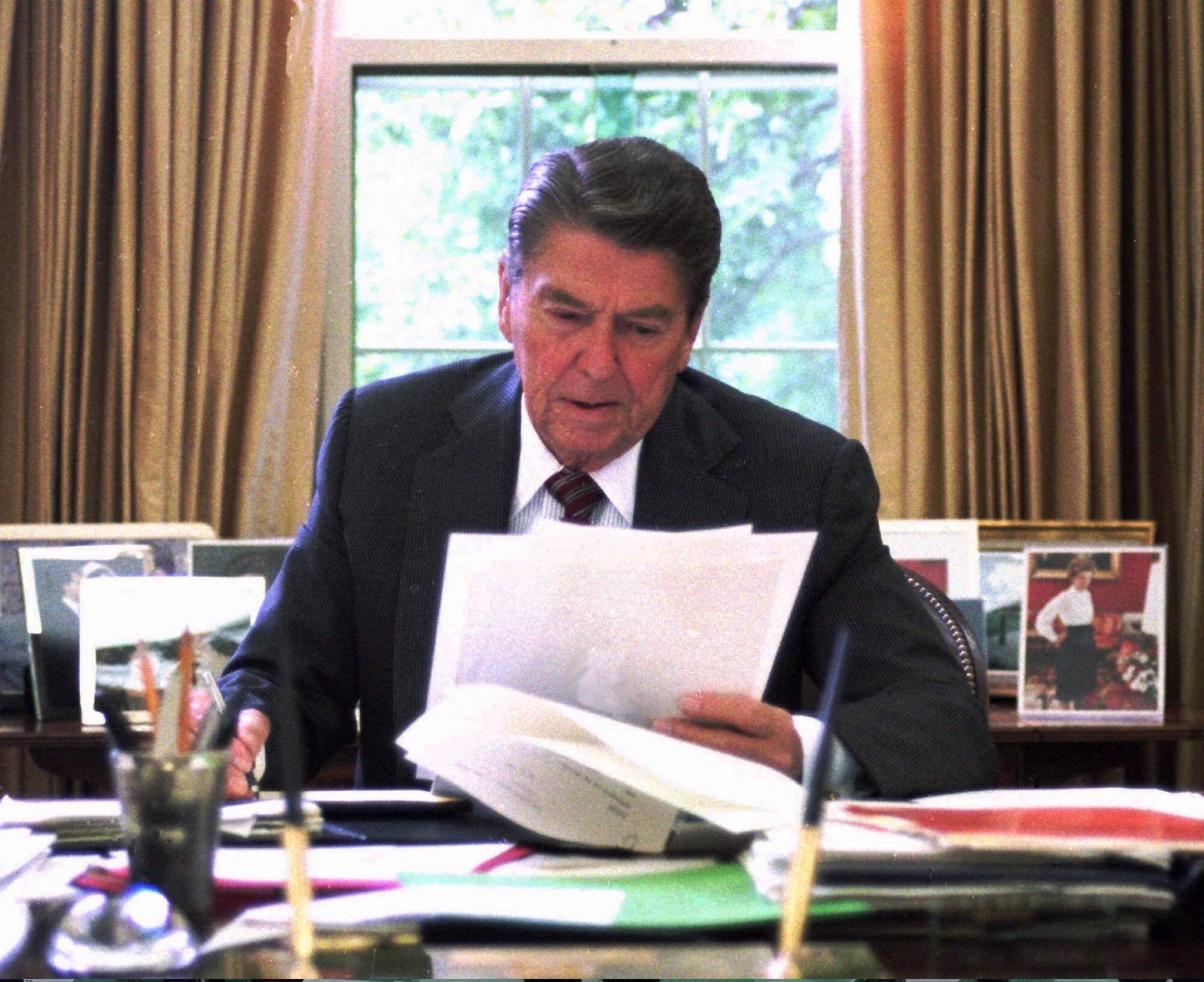 A 1987 file photo of President Ronald Reagan in the Oval Office. John Hinckley, who was found not guilty of insanity for shooting Reagan and three others in March 1981, has been approved for release from a mental institution with restrictions. (AP file photo)