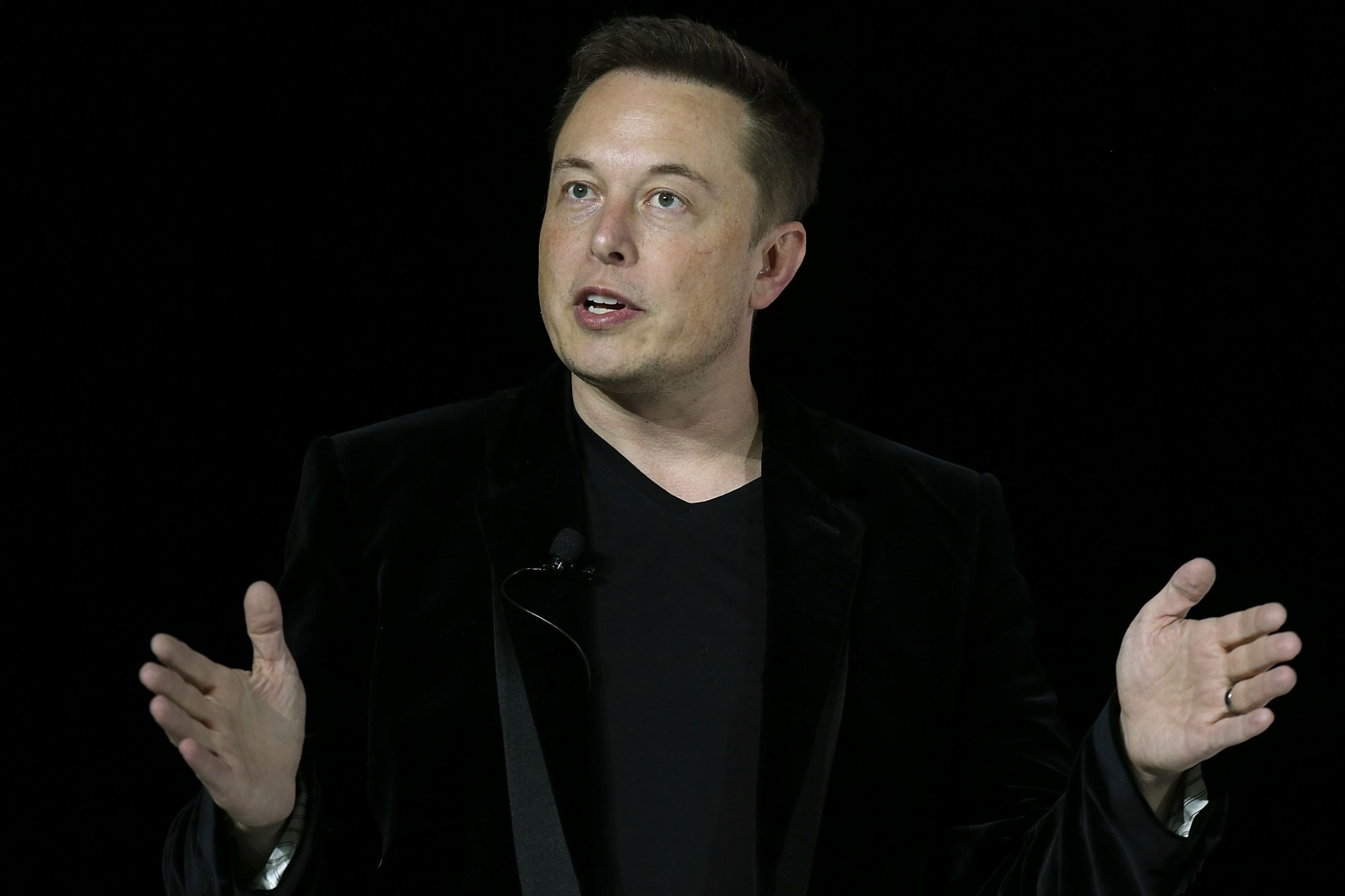"Tesla Motors CEO Elon Musk says combining the electric vehicle and battery maker with SolarCity will create ""the world's only vertically integrated sustainable energy company.""  (Getty Images)"
