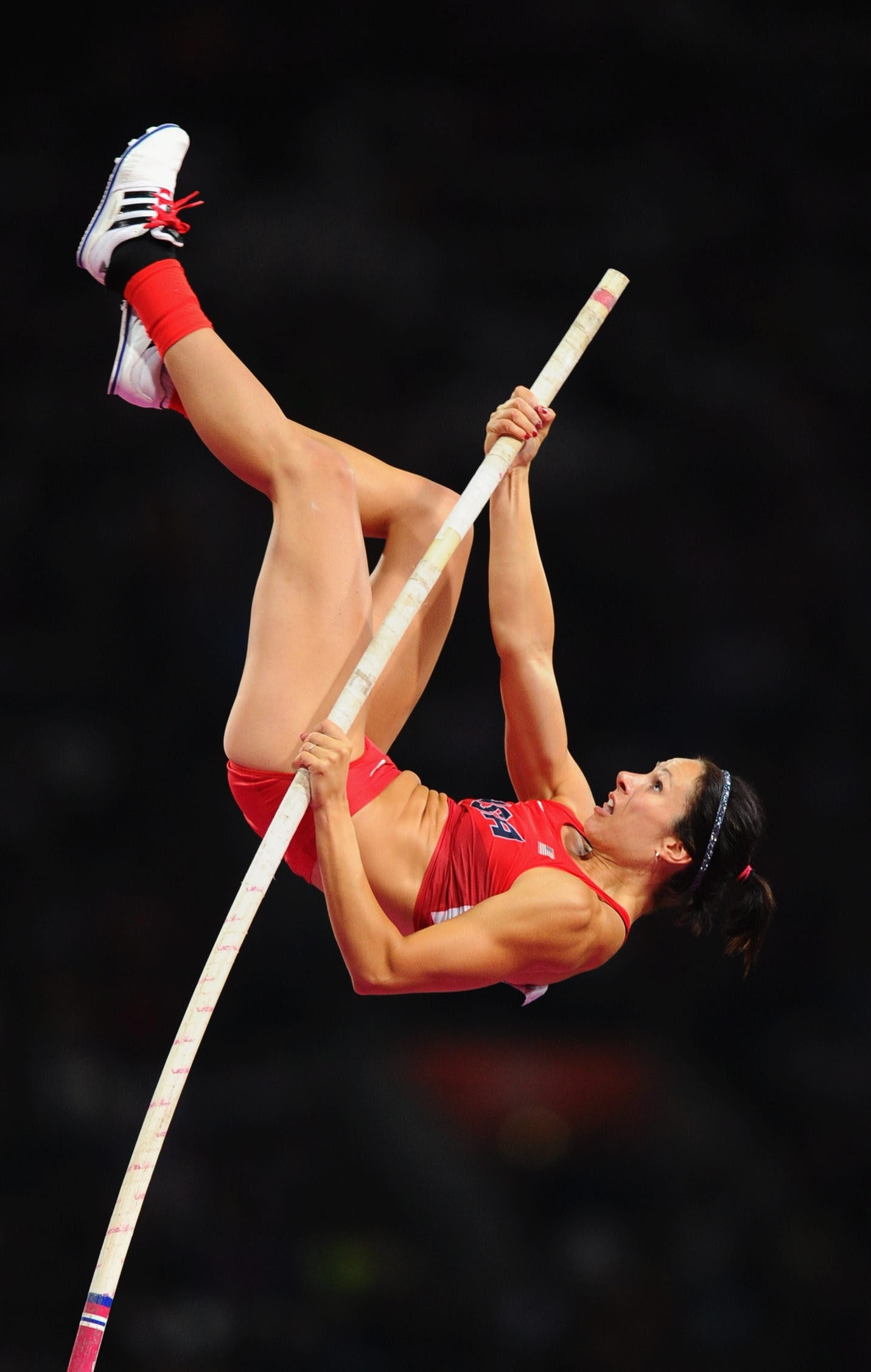 Jenn Suhr competes in the 2012 Games, where she won the gold.