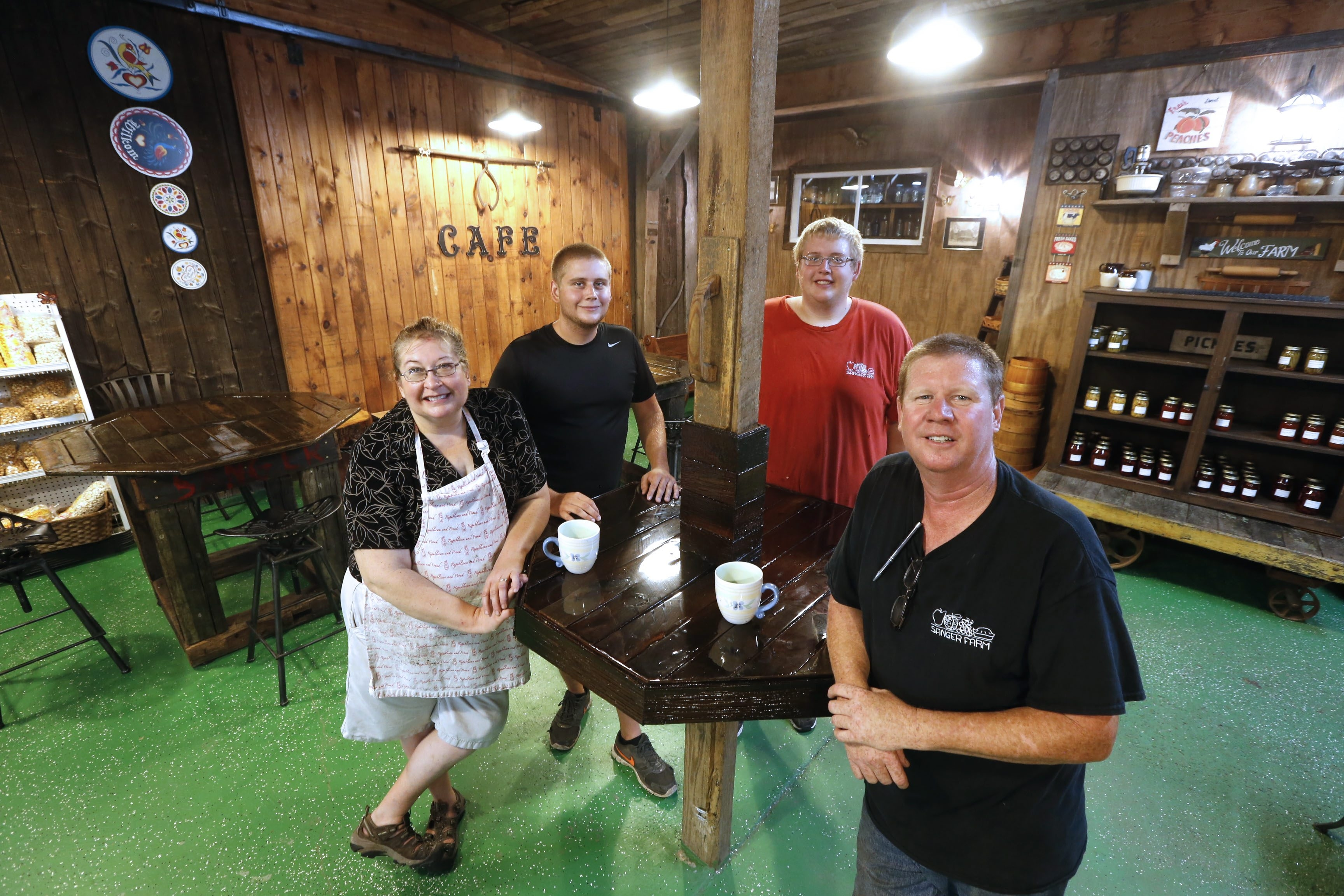From left: Sandra Sanger Tuck, sons Claitan and Rogan, and her husband, Mike, are venturing into agritourism with their café.