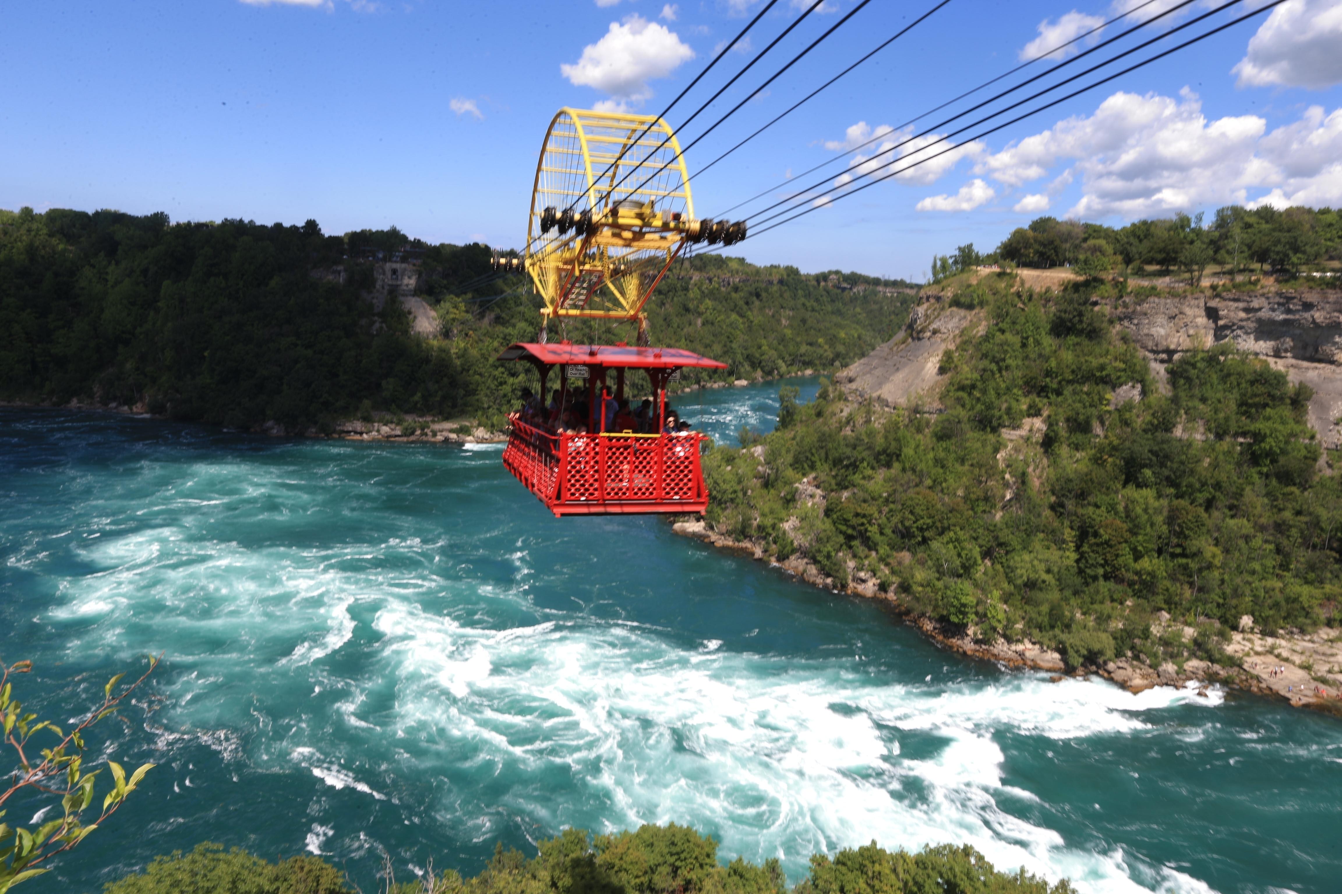 Tourists and visitors to Niagara Falls ride the Whirlpool Aero Car, or Spanish Aero Car, above the Whirlpool Rapids of the Lower Niagara River on Sunday, Aug. 7, 2016. (John Hickey/Buffalo News)