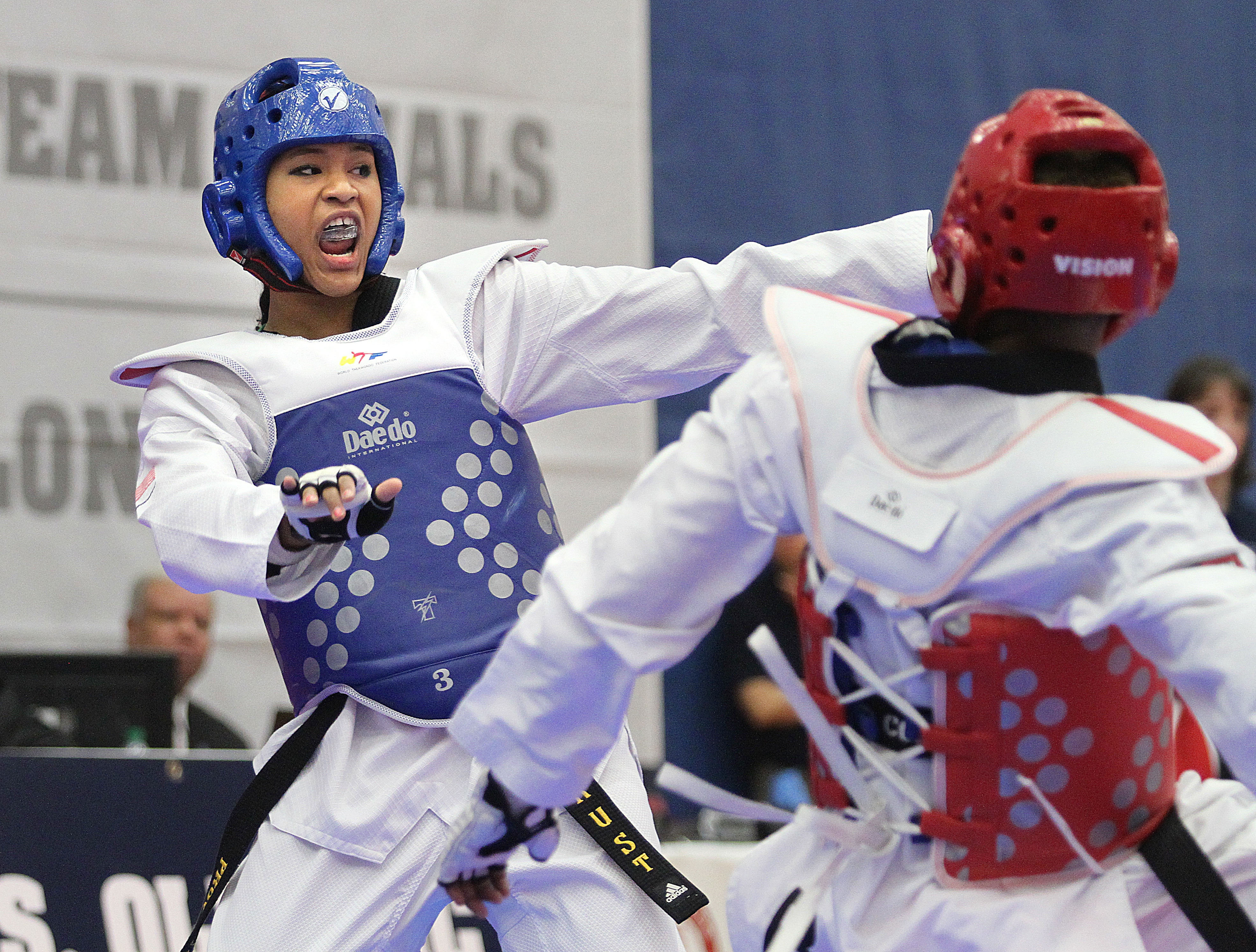 Paige McPherson, in blue, goes after Nia Abdallah during the 2012 Taekwondo Olympic Trials at the U.S. Olympic Training Center in Colorado Springs, Colo. McPherson won the match 5-4.