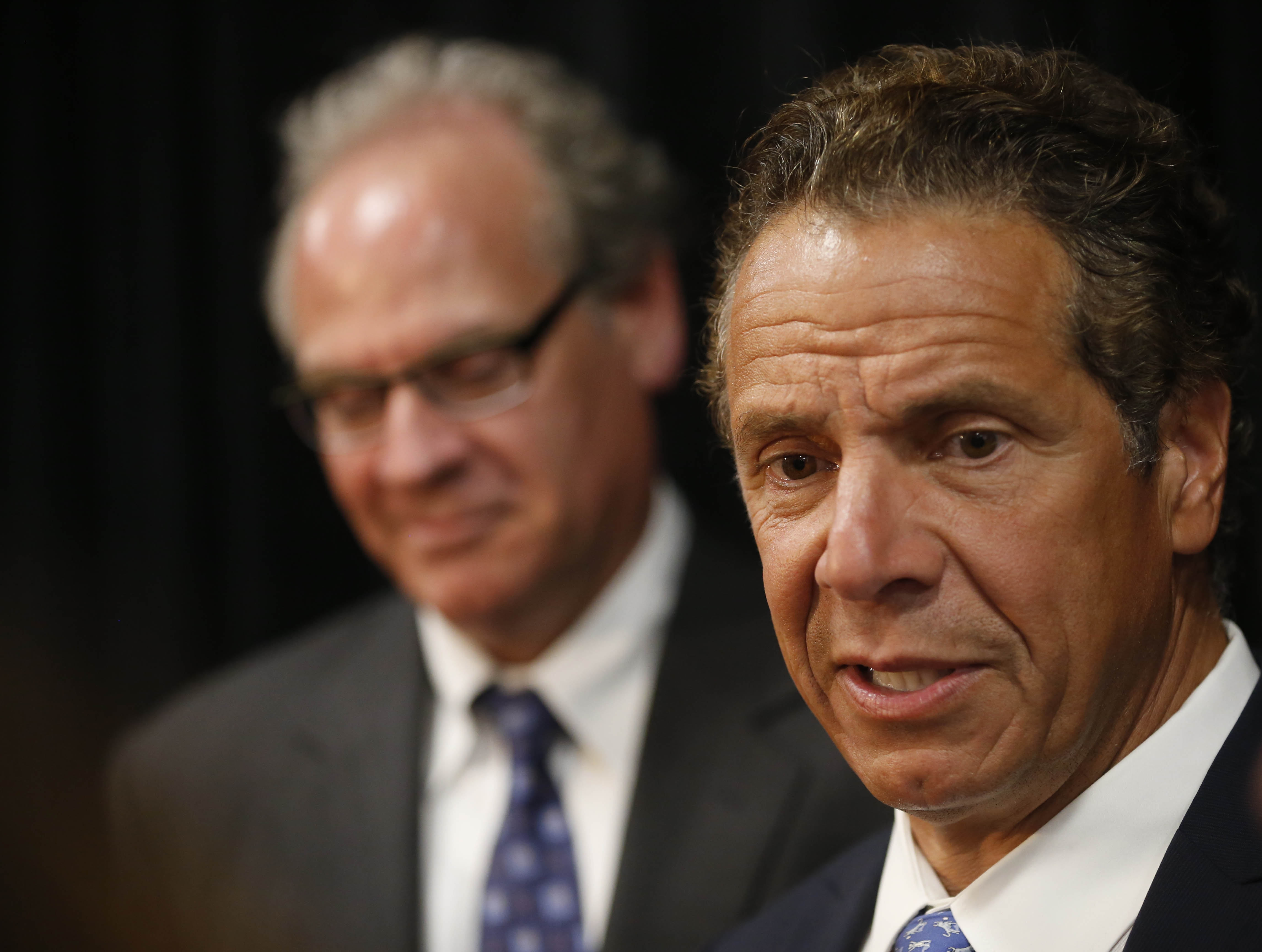 New York Gov. Andrew Cuomo speaks with the media following an event to announce that Geico will add 600 new jobs to its call center in Amherst. (Derek Gee/Buffalo News)
