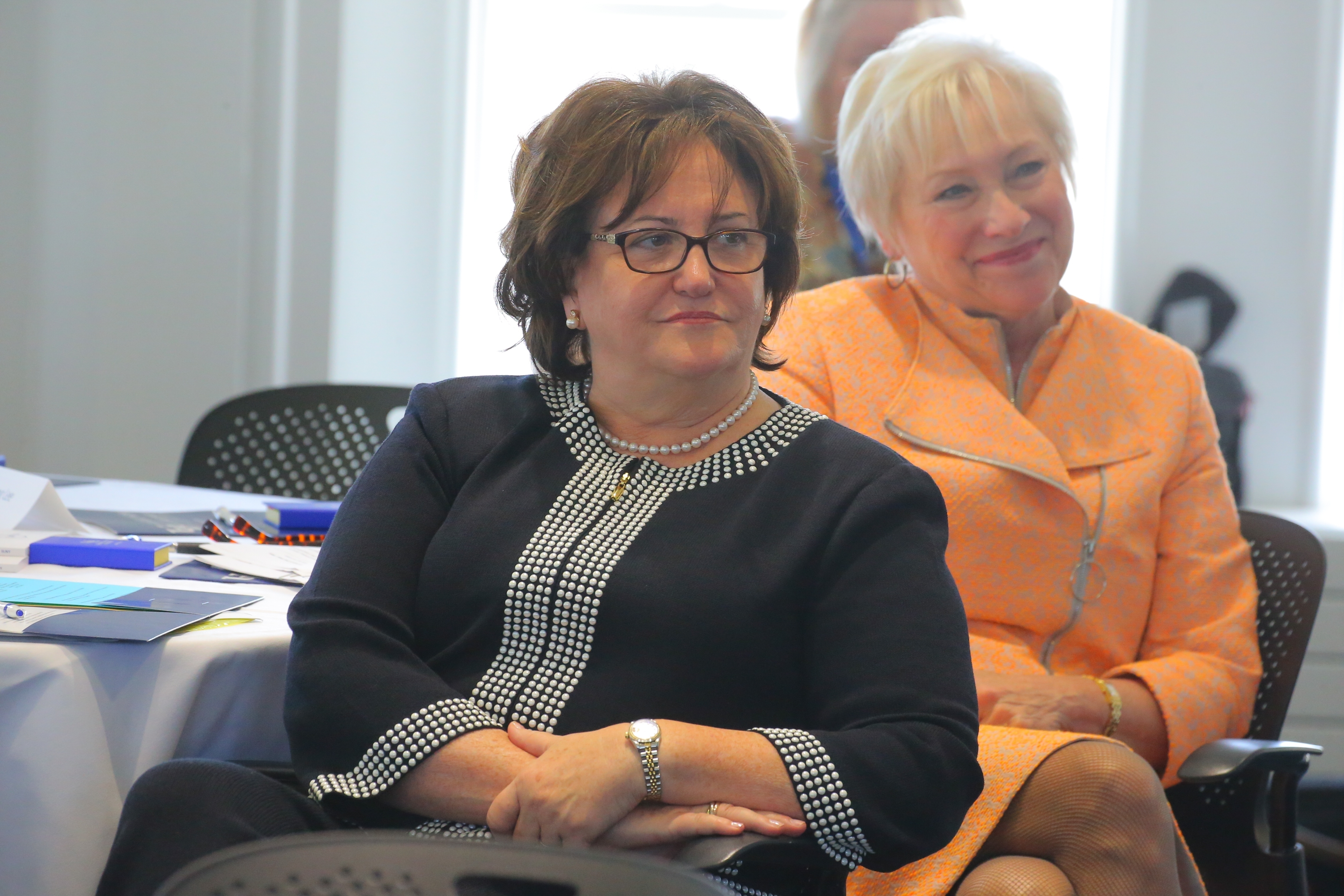 Mary Ellen Elia and Nancy L. Zimpher listen to teachers discuss the current state of teaching in Hayes Hall at UB on Tuesday.