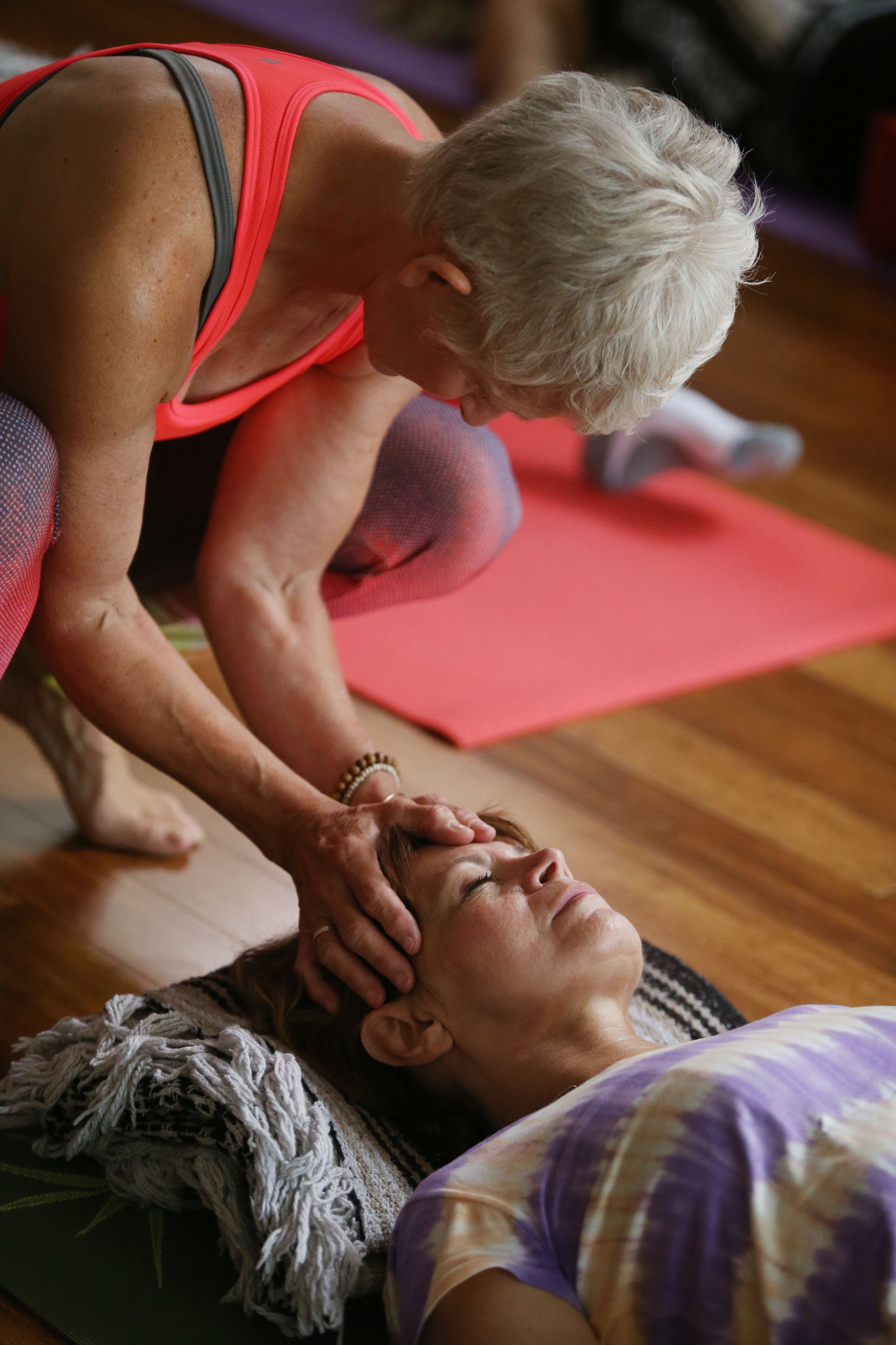 beHealthy Institute is a wellness center at 40 Main St. in Hamburg. Instructor Holly Maloney performs raiki with aromatherapy on Janet Speciale at the end of a yoga class, Wednesday, Aug. 10, 2016.   (Sharon Cantillon/Buffalo News)