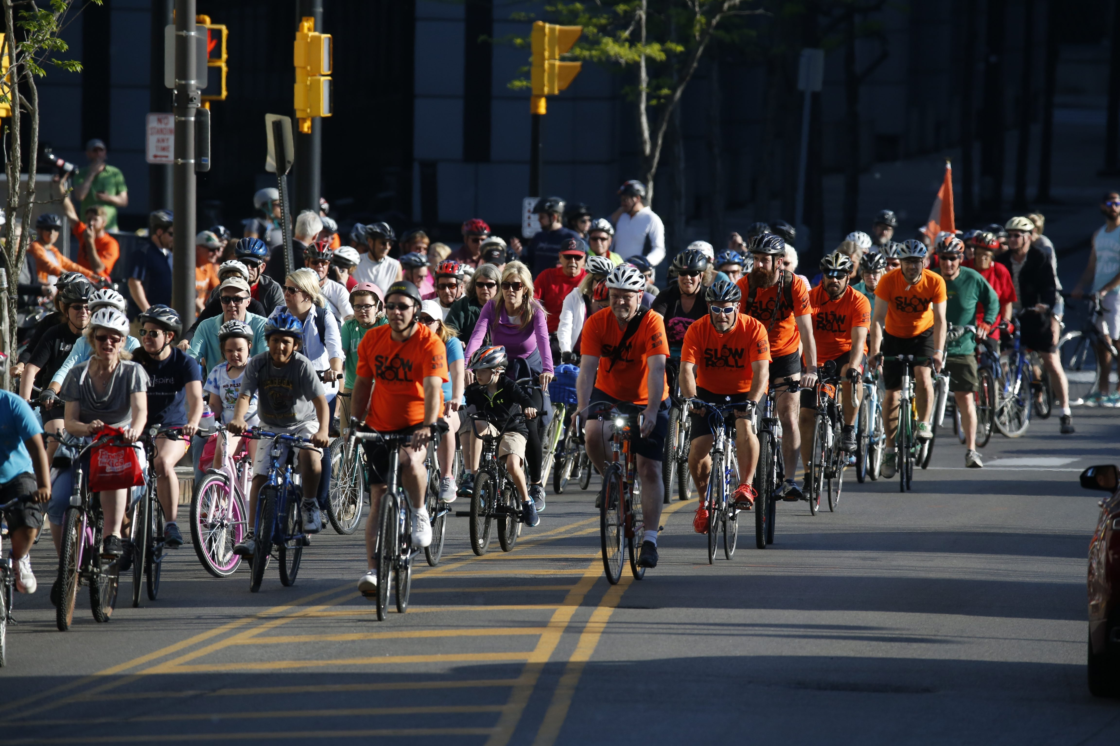 Slow Roll riders make their way up Washington Street in May. Slow Roll organizers have promised riders will be sure not to block access to hospitals after a Buffalo General staffer complained on Facebook. (Harry Scull Jr./Buffalo News file photo)