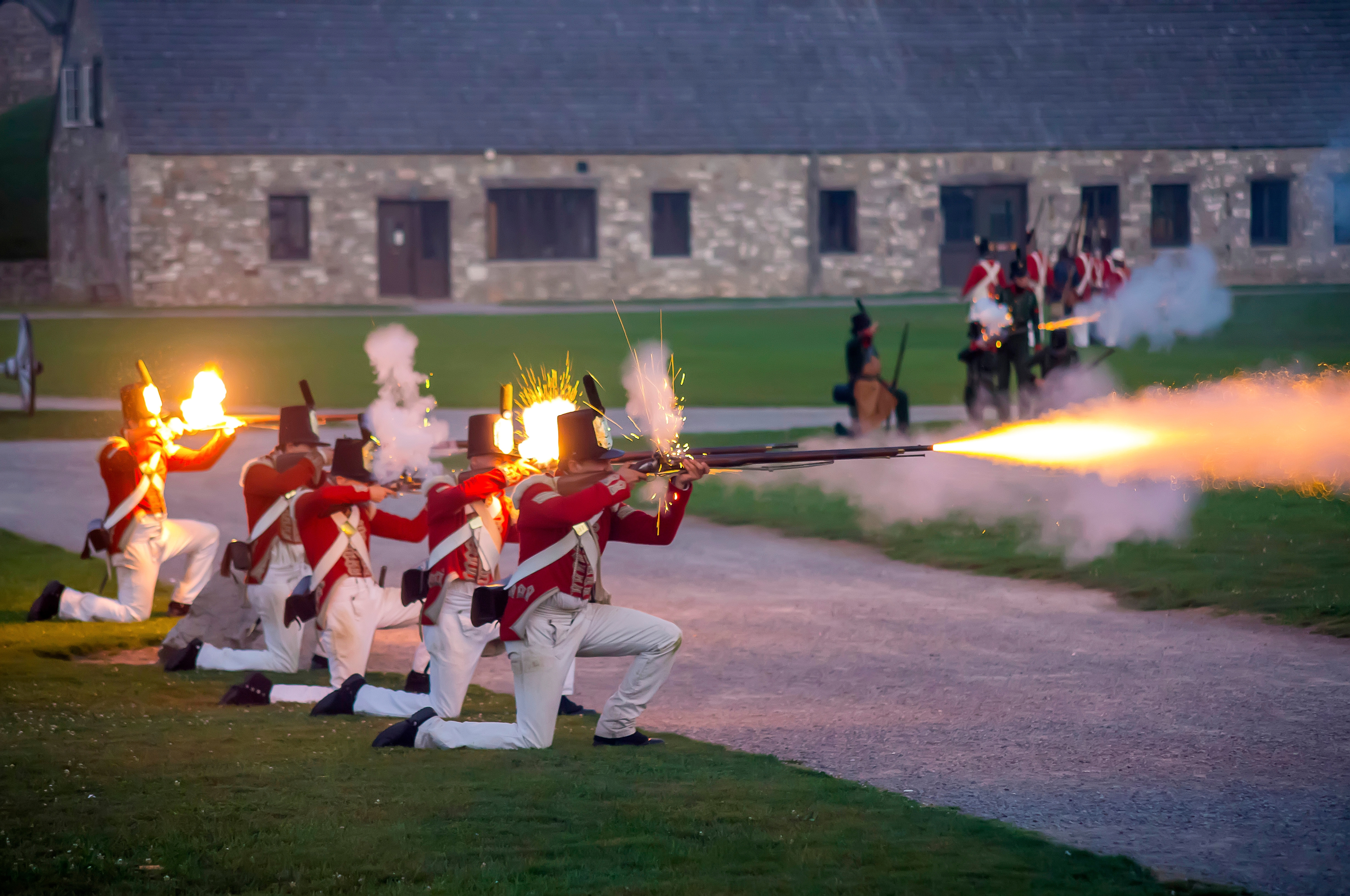 Re-enactors wearing British uniforms at Old Fort Niagara will be back for the War of 1812 Encampment next weekend.