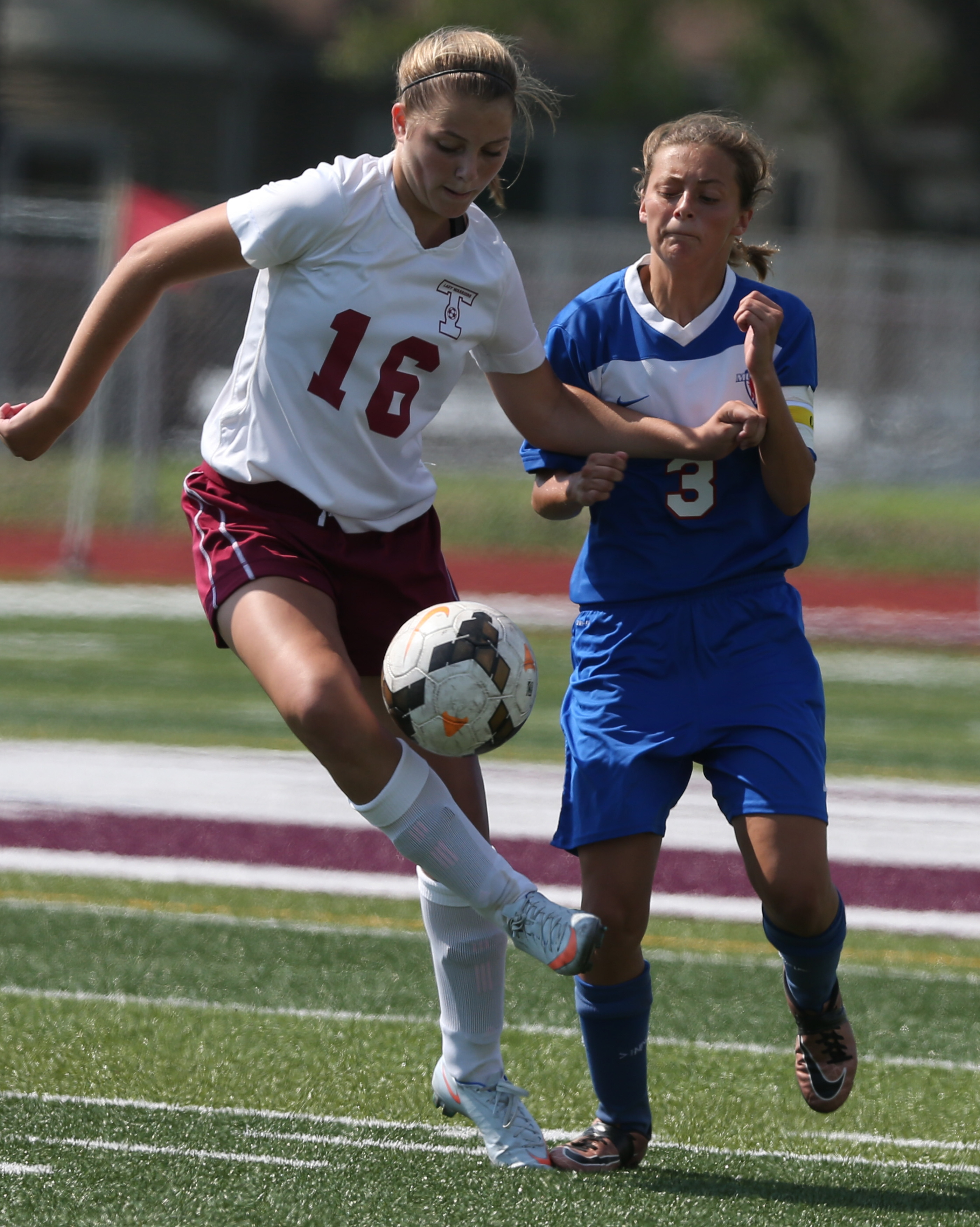 Tonawanda's  Zoe Oliver battles Medina's Martha Gardner for the ball in the first half at Clint Small Stadium in Tonawanda. At right, Sweet Home's Patrick Hayte and North Tonawanda's Griffin Carson use their heads to keep the ball in play.