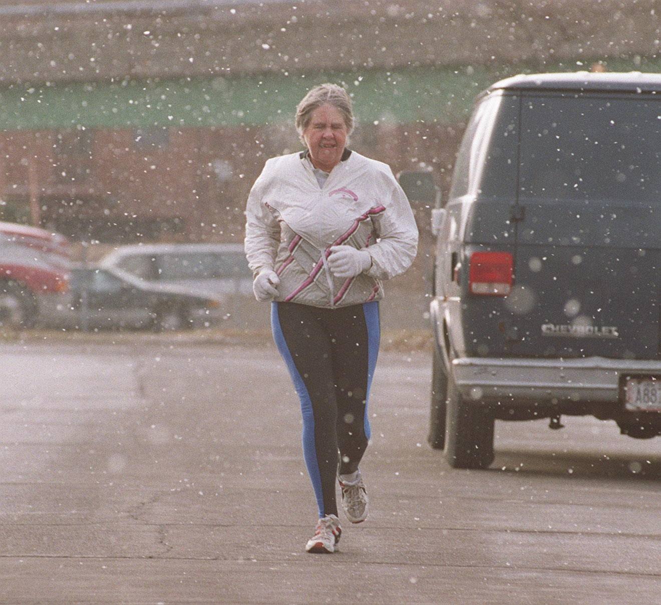 Despite the snow, longtime runner Edna Hyer takes her lunch-hour jog down Carolina Street in downtown Buffalo on Jan. 5, 2000.