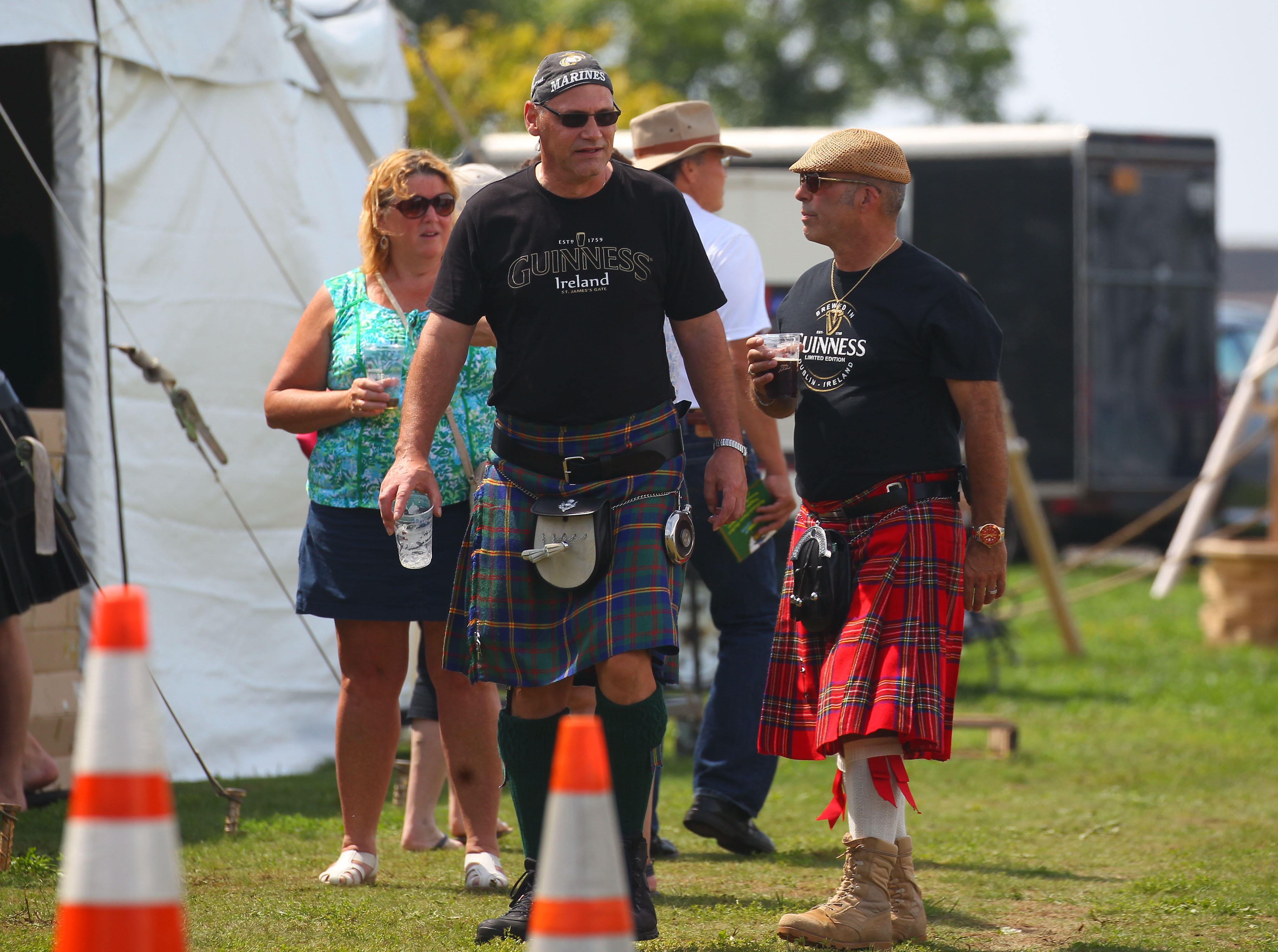Marty Bugal, left, and Eddy Valasquez wear their kilts during the Buffalo Irish Festival at Wilkeson Point in Buffalo on Sunday, August 28, 2016. (Mark Mulville/Buffalo News)