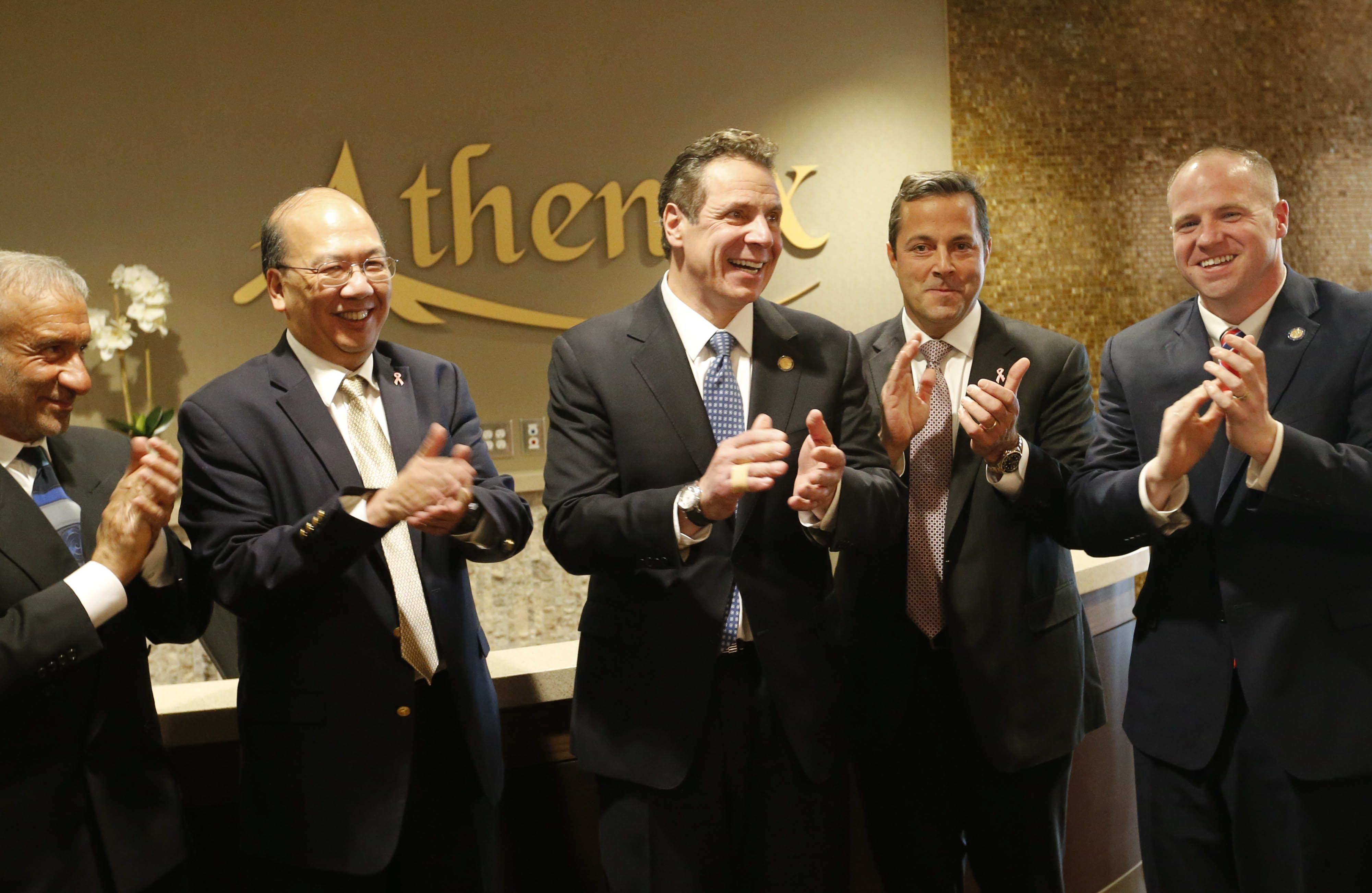 From left, Alain E. Kaloyeros, CEO of SUNY Polytechnic Institute, Athenex CEO Johnson Y. N. Lau, Gov. Cuomo, Athenex COO Flint Besecker and State Sen. Tim Kennedy applaud after a ribbon-cutting to mark the opening of the new Athenex facility at Conventus in Buffalo, Thursday, Feb. 11, 2016. (Derek Gee/Buffalo News)